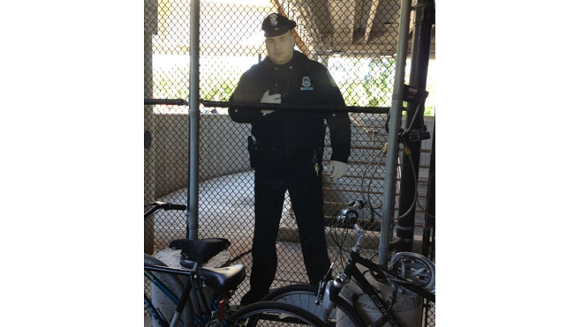 As part of an effort to cut crime, transit police placed a cardboard cutout of a police officer in the bicycle cage.