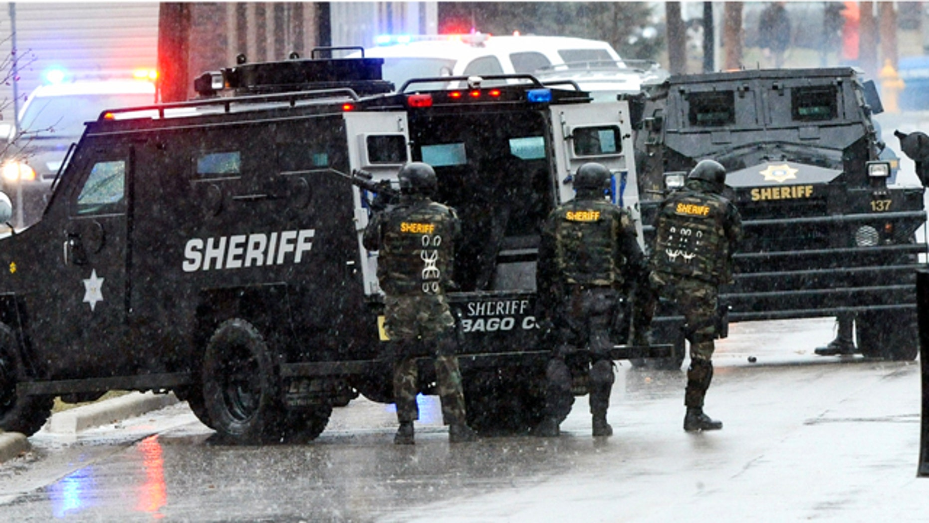 March 20, 2011: Swat team members arrive outside the home of a suspect who shot a Fond du Lac police officer