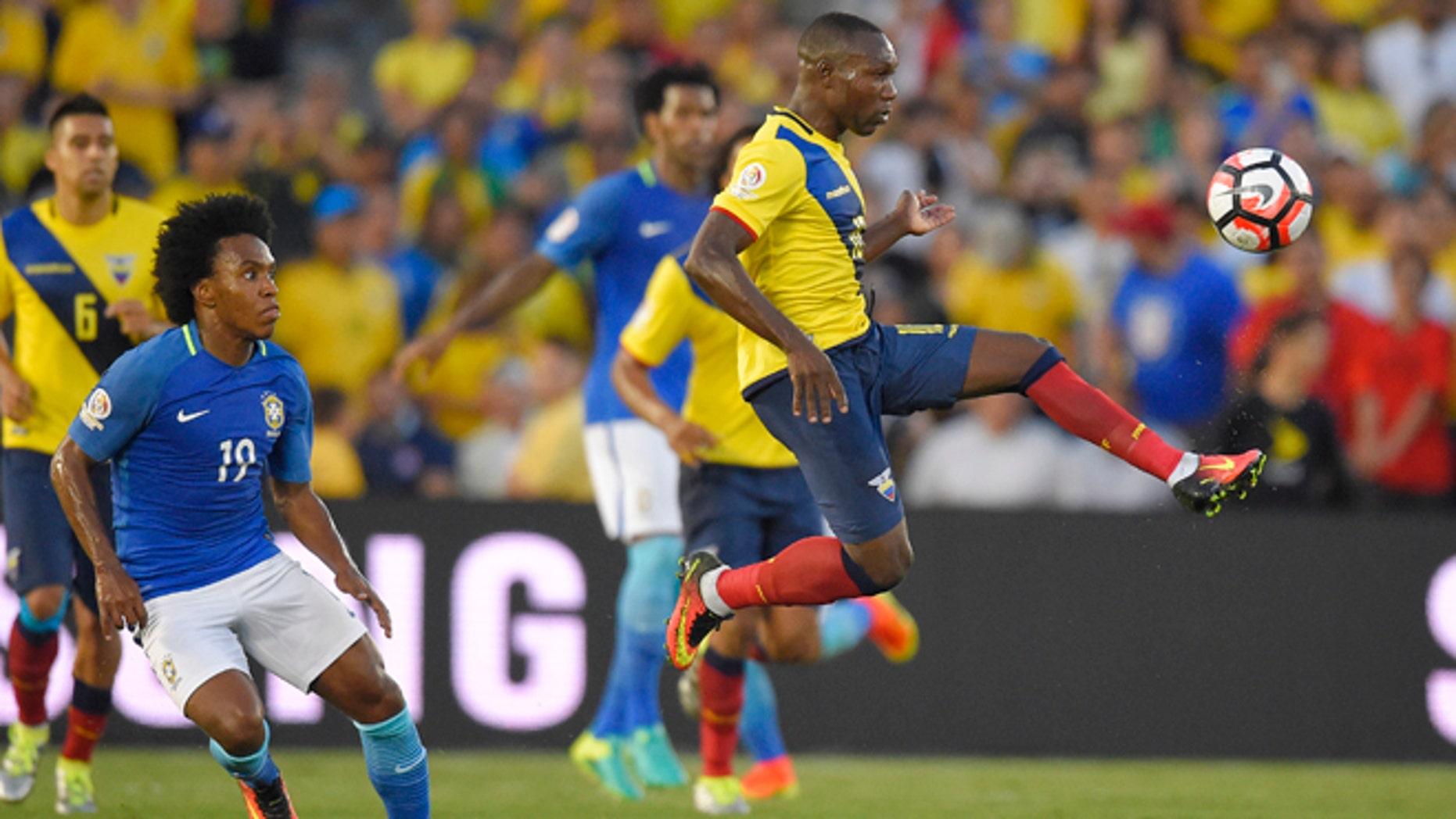 Ecuador midfielder Walter Ayovi, right, kicks the ball as Brazil midfielder Willian, left, watches during a Copa America group B soccer match at the Rose Bowl, Saturday, June 4, 2016, in Pasadena, Calif. (AP Photo/Mark J. Terrill)