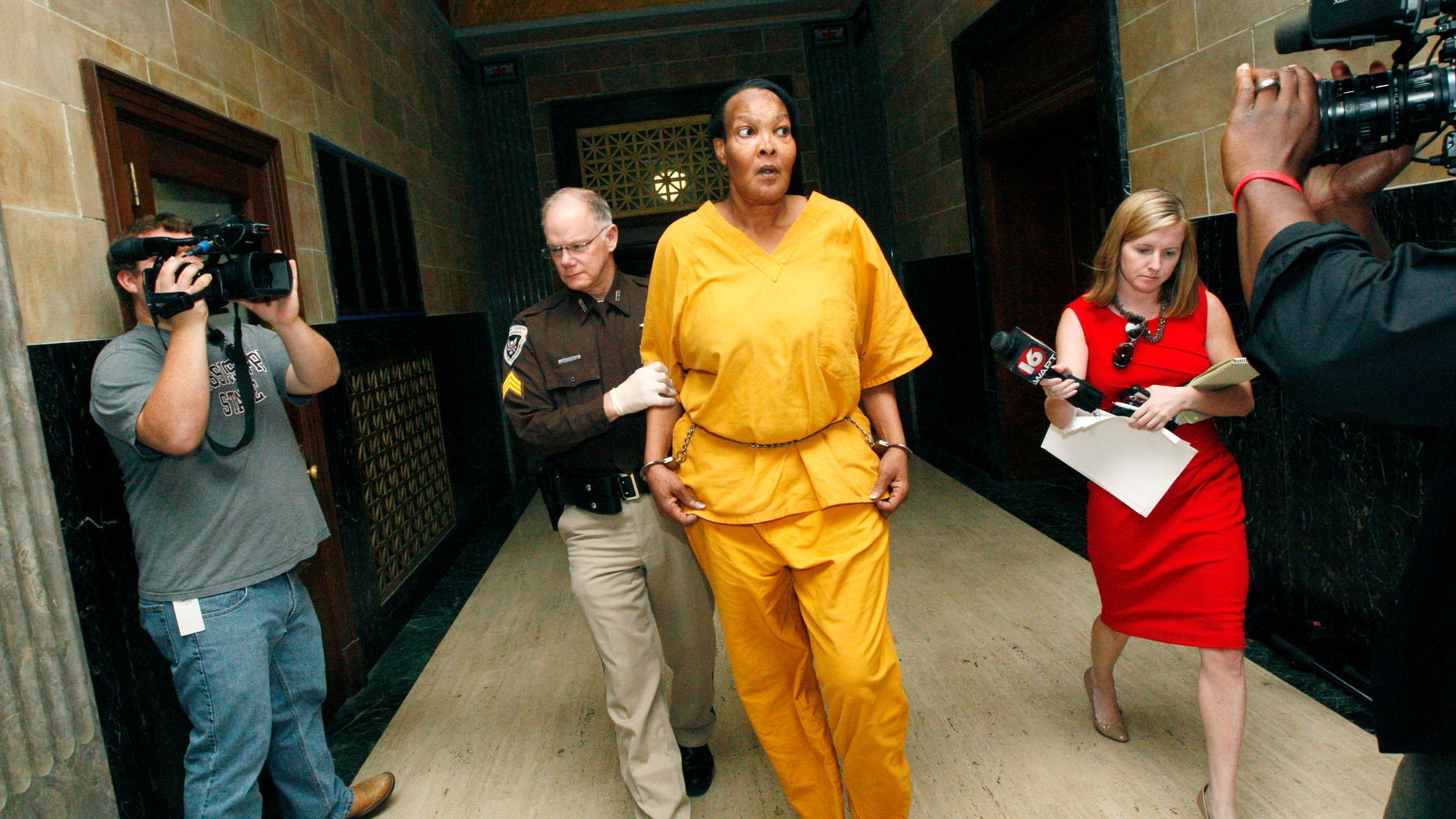 Sept. 11, 2012: Morris Garner, who also goes by the name Tracey Lynn Garner, is escorted from a Hinds County courtroom by bailiff Tony Queen in Jackson, Miss., following a bond hearing.