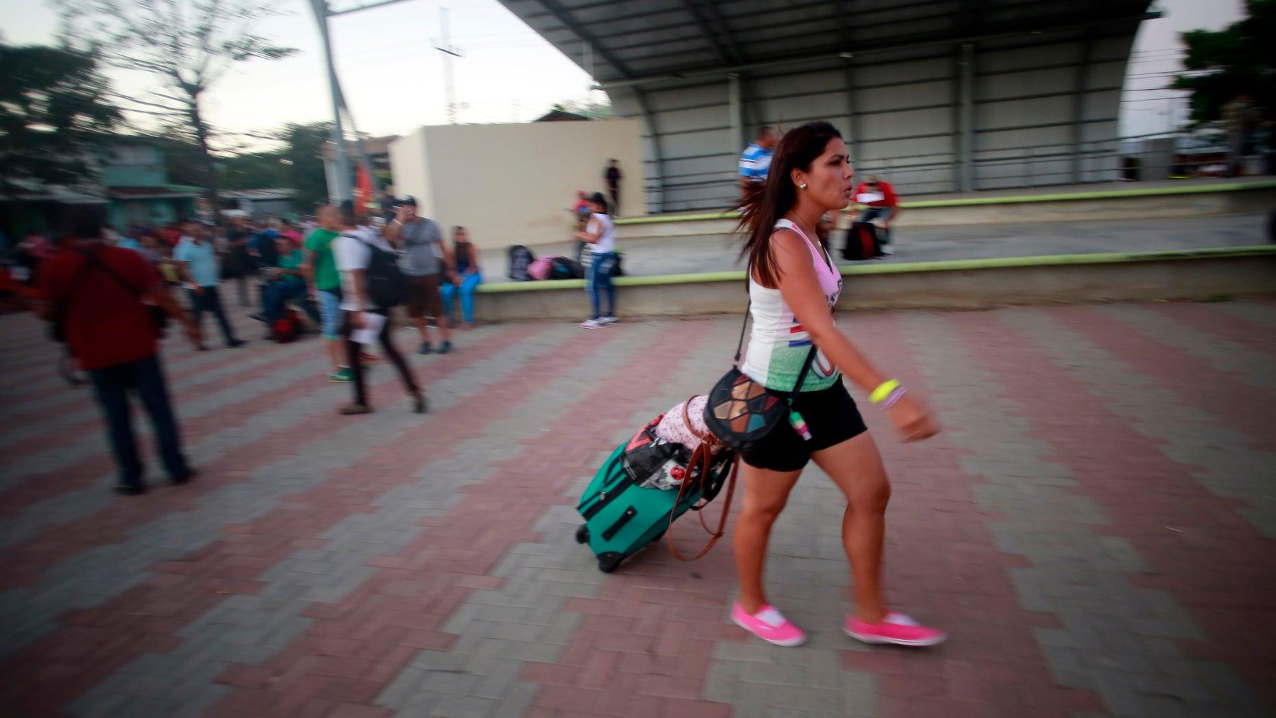 A Cuban migrant walks to the airport in La Cruz, Costa Rica, Tuesday, Jan. 12, 2016.