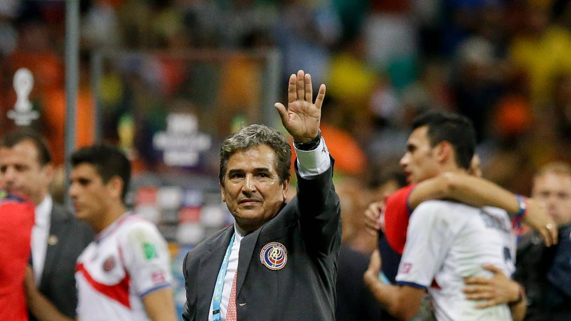 FILE - In this July 5, 2014 file photo, Costa Rica head coach Jorge Luis Pinto waves after a penalty shoot out during the World Cup quarterfinal soccer match between the Netherlands and Costa Rica at the Arena Fonte Nova in Salvador, Brazil.  The Colombia-born manager has decided to leave the Costa Rica national team. (AP Photo/Matt Dunham, File)