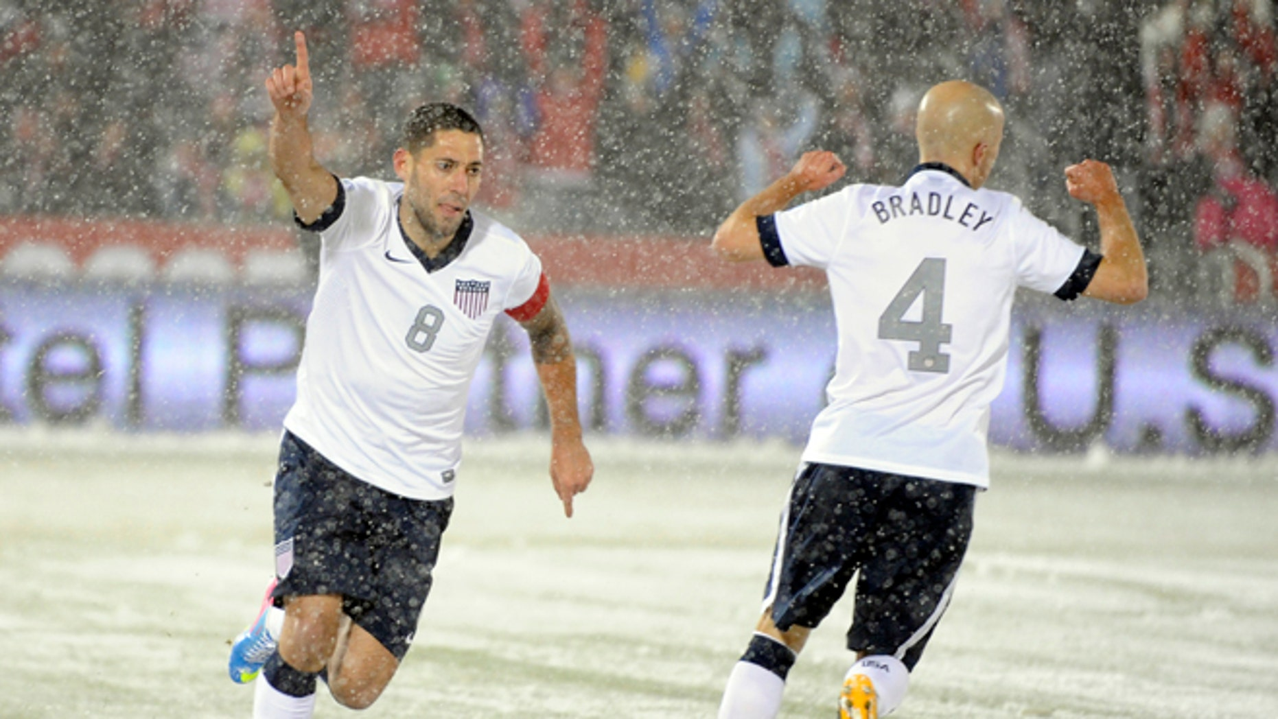 United States forward Clint Dempsey (8) celebrates a goal with Michael Bradley (4) against Costa Rica during the first half of a World Cup qualifier soccer match in Commerce City, Colo., Friday, March 22, 2013. (AP Photo/Jack Dempsey)
