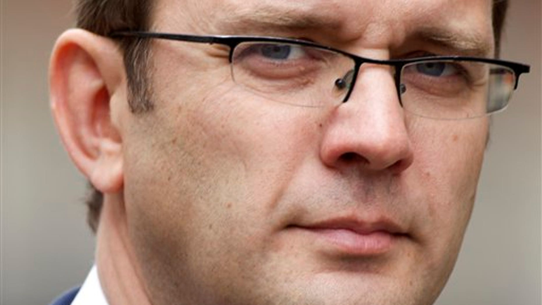 May 10, 2012: In this file photo, Andy Coulson, the former editor of the News of the World newspaper and former director of communications for Britain's Prime Minister David Cameron arrives to appear at the Leveson Inquiry at the High Court in London.