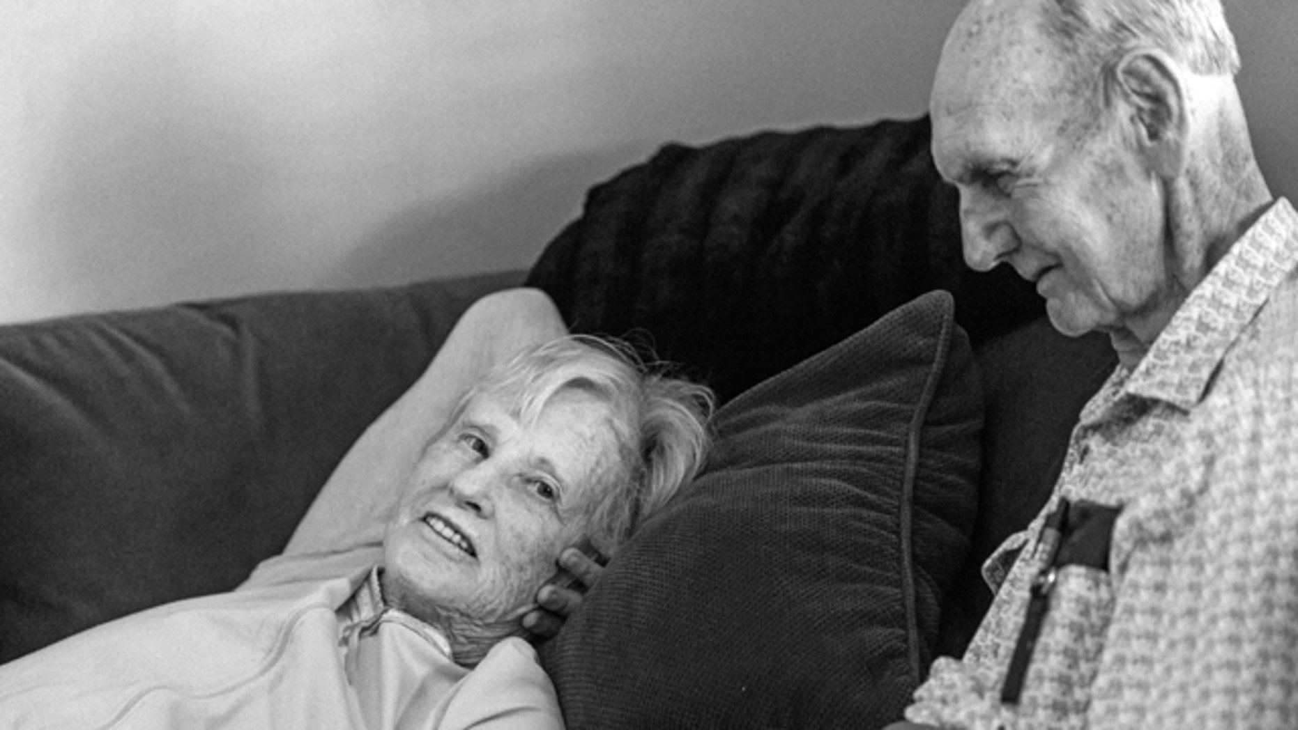 In this July, 2014 photo provided by their granddaughter Melissa Stone, Don Simpson, 90, and his wife Maxine, 87, share time together in Sloan's home in Bakersfield, Calif. The couple, married 62 years, died four hours apart July 21, 2014, while lying next to each other, their family said. (AP Photo/Melissa Sloan)
