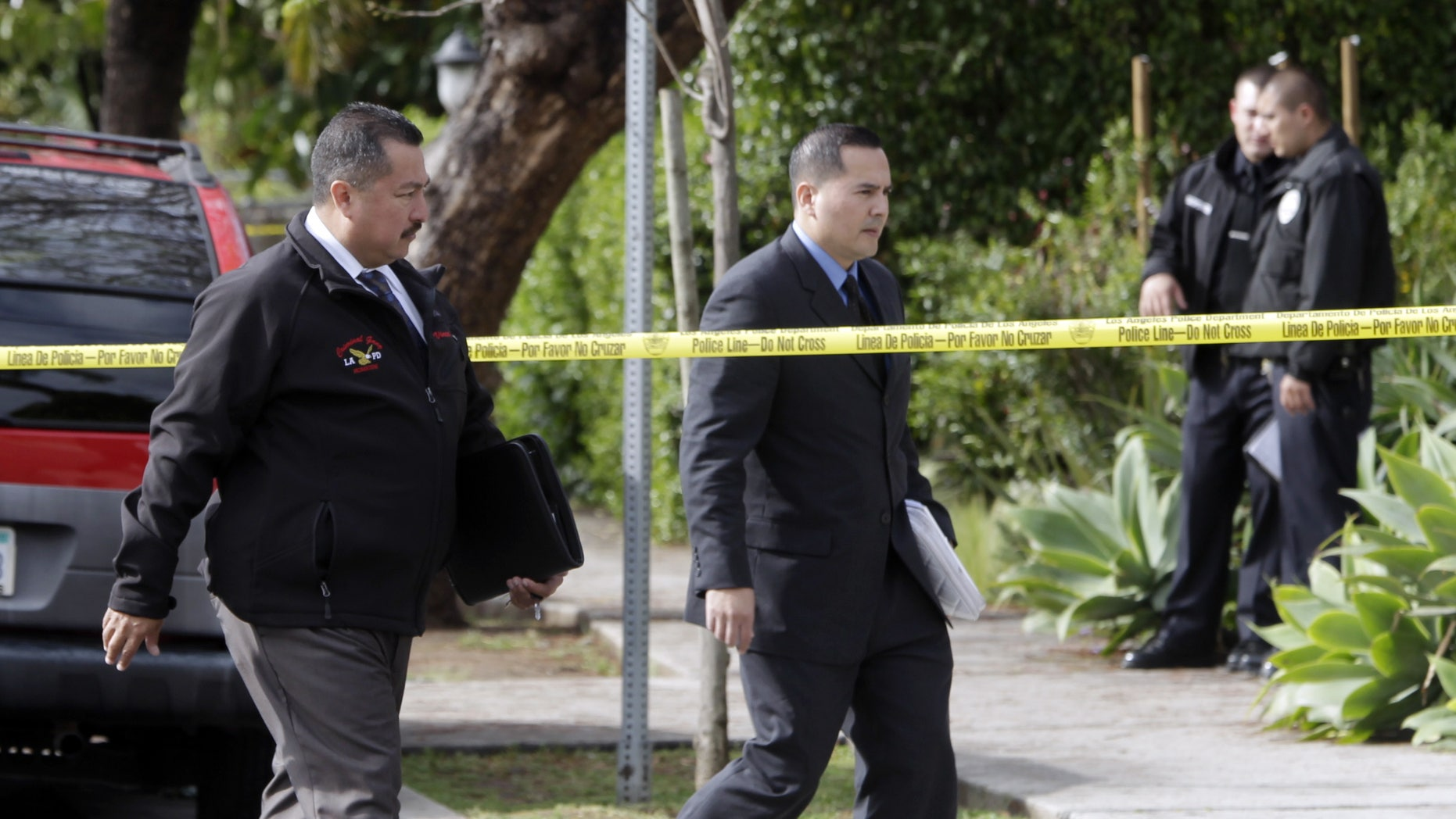 April 11: LAPD investigators work at the scene of a shooting of two USC students in Los Angeles. Police said a gunman opened fire on a BMW near the University of Southern California campus, killing two international students from China in what may have been a bungled carjacking attempt.