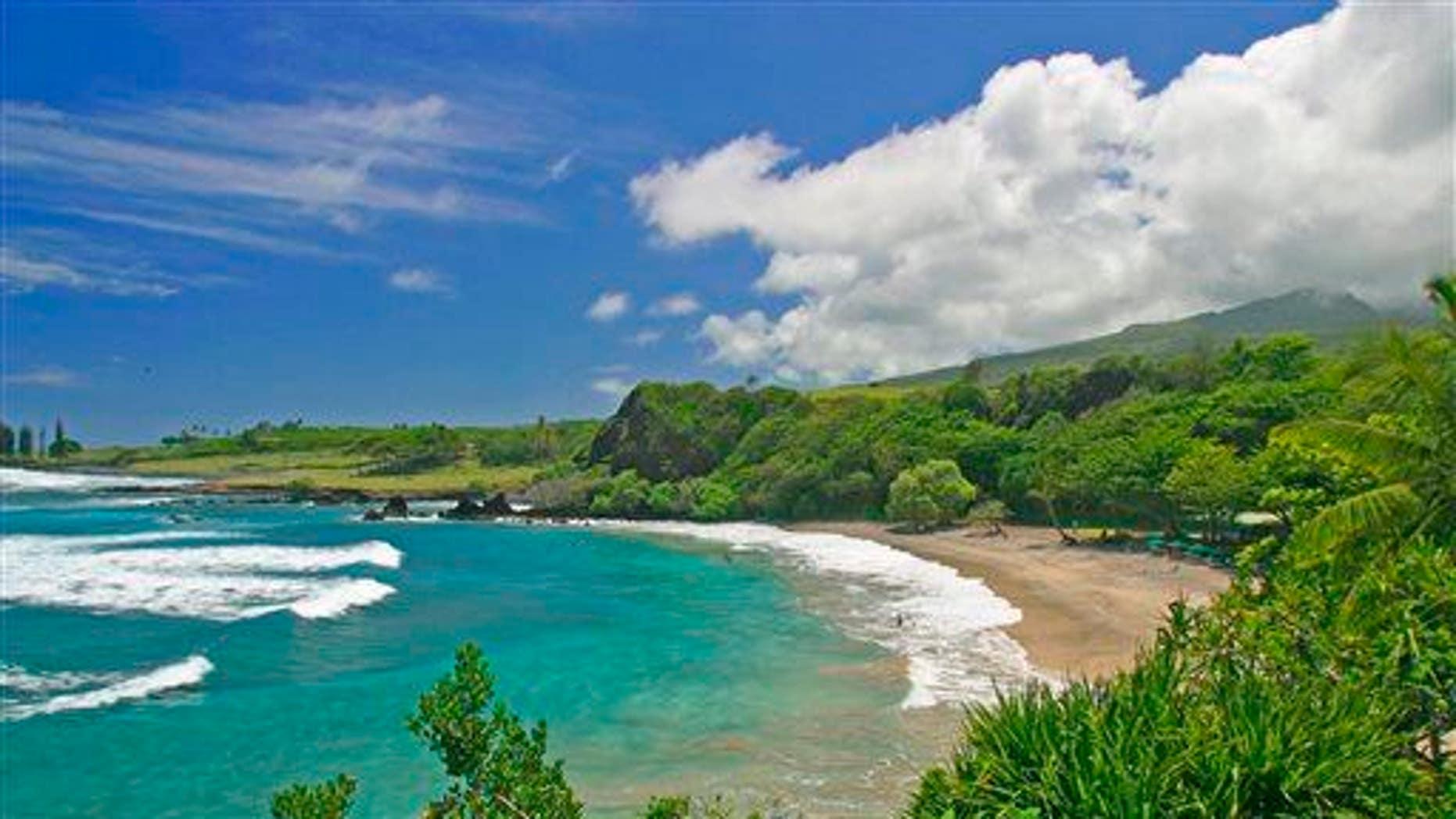 This undated file photo provided by Ron Dahlquist for the Maui Visitors Bureau shows Hamoa Beach in Maui, Hawaii.