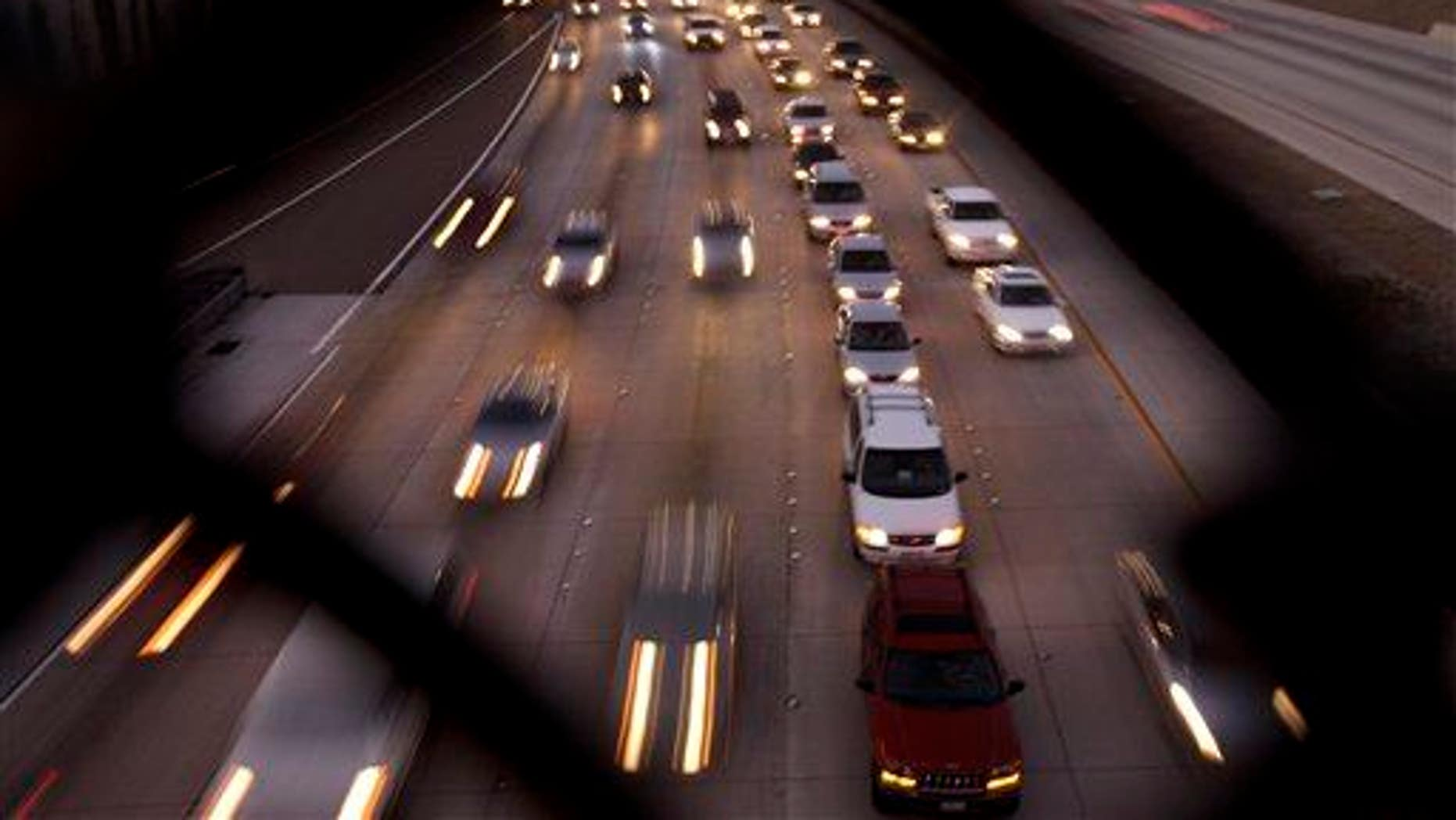In this 2011 file photo, cars fill the highway in San Diego.