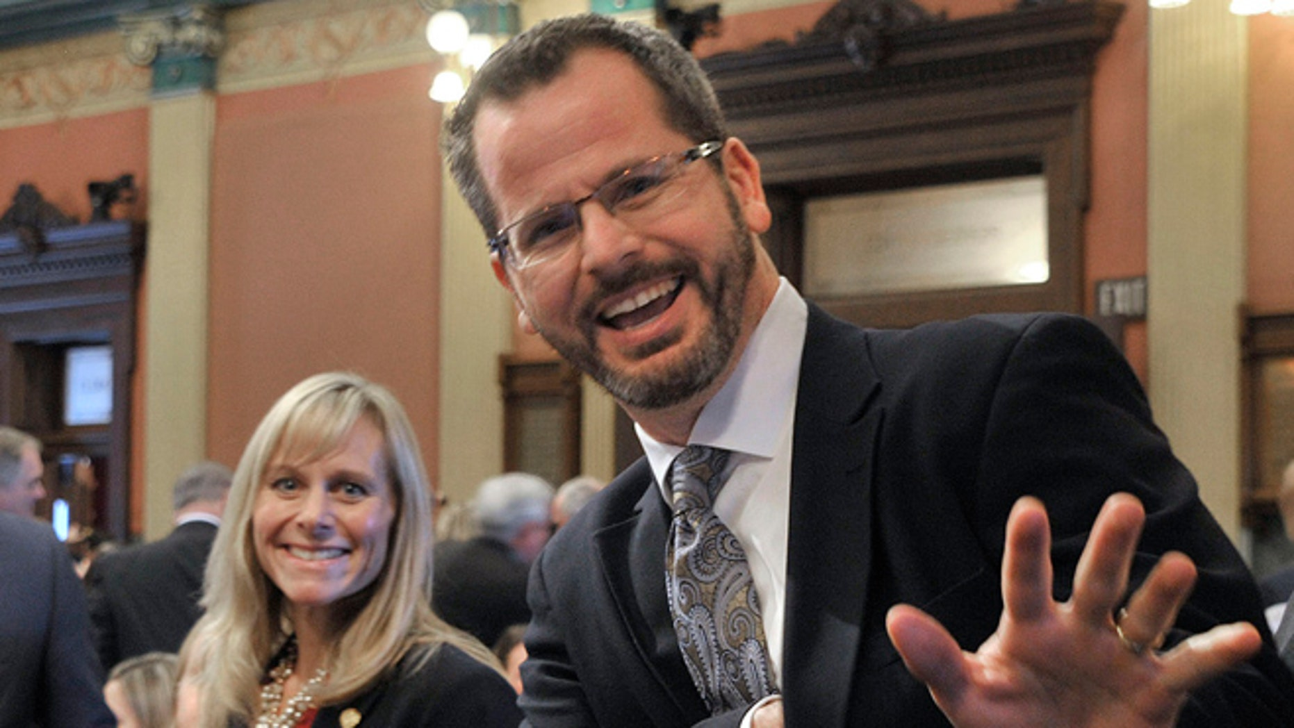 In this Jan. 14, 2015 photo, Michigan state Rep. Cindy Gamrat and state Rep. Todd Courser wave to reporters in the House of Representatives in Lansing.