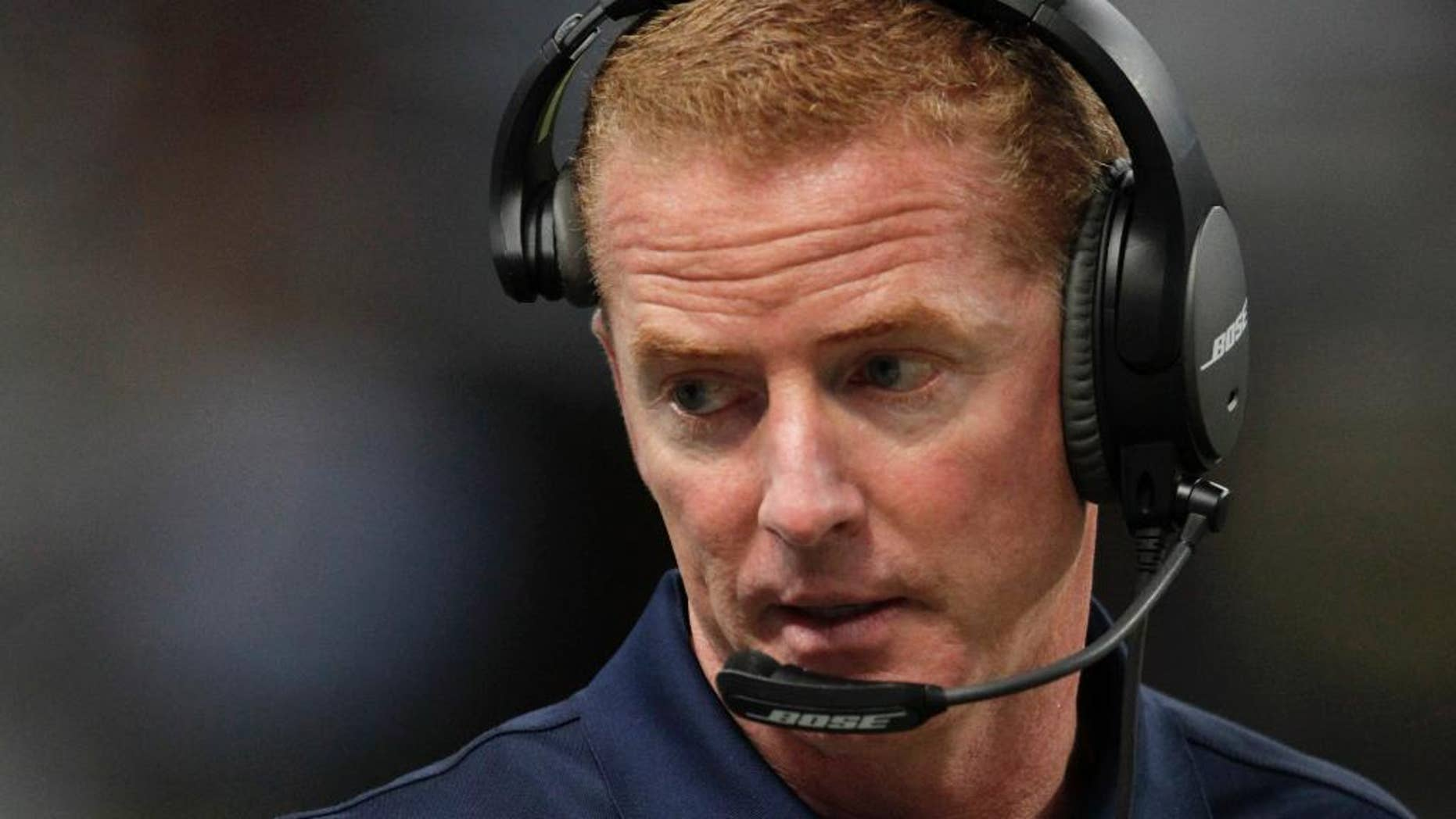 FILE - In this Sept. 21, 2014, file photo, Dallas Cowboys head coach Jason Garrett watches from the sidelines during the third quarter of an NFL football game against the St. Louis Rams in St. Louis. The Dallas Cowboys overcame a 21-point deficit to win in regulation for the first time in team history. (AP Photo/Tom Gannam, File)