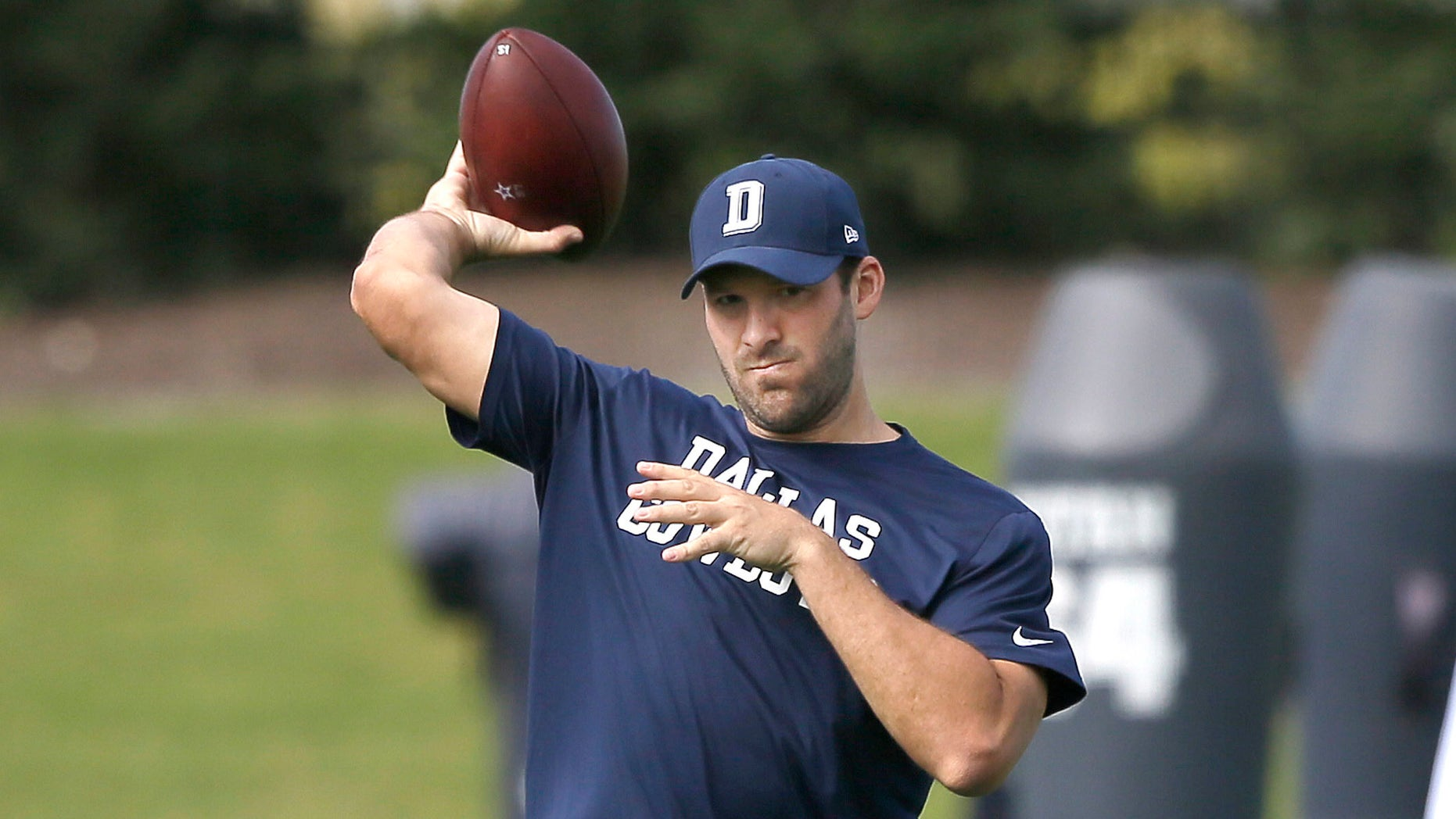 Dallas Cowboys quarterback Tony Romo throws during NFL football practice at the team's practice facility in Frisco, Texas, Wednesday, Oct. 26, 2016. (AP Photo/LM Otero)