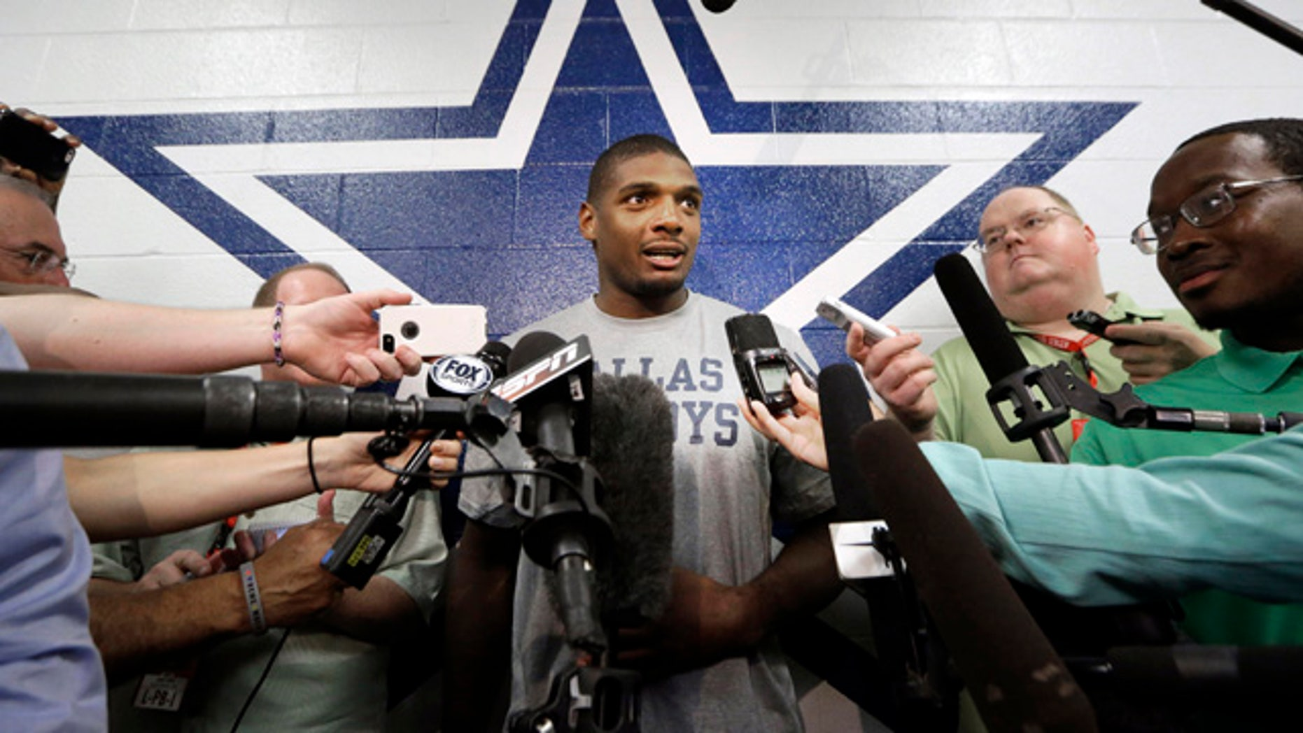 September 3, 2014: Dallas Cowboys practice squad player defensive end Michael Sam speaks to reporters after team practice at the team's headquarters in Irving, Texas. (AP Photo/LM Otero)