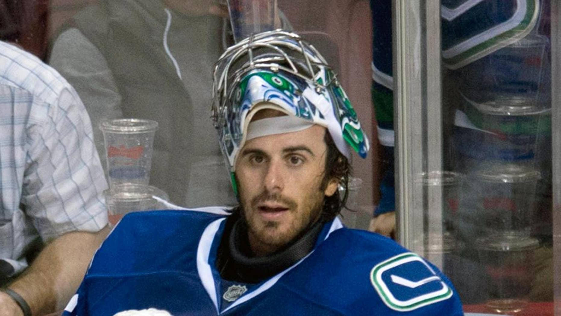 Vancouver Canucks goalie Ryan Miller prepares to leave the bench following the Canucks loss to the Arizona Coyotes in Vancouver, British Columbia, Monday, Sept. 29, 2014. (AP Photo/The Canadian Press, Jonathan Hayward)