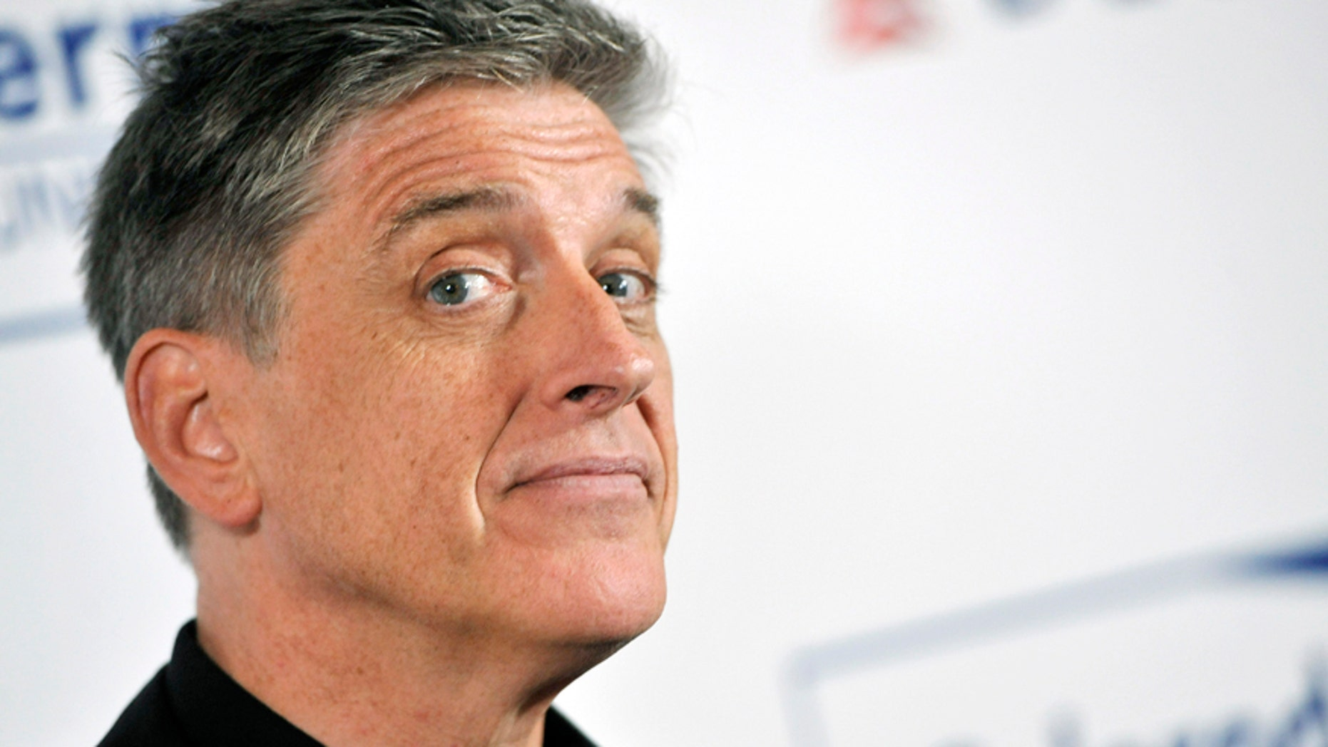 In this April 30, 2013, file photo, comedian Craig Ferguson poses at the Cool Comedy's Hot Cuisine Benefit for the Scleroderma Research Foundation at the Four Seasons Hotel in Beverly Hills, Calif.