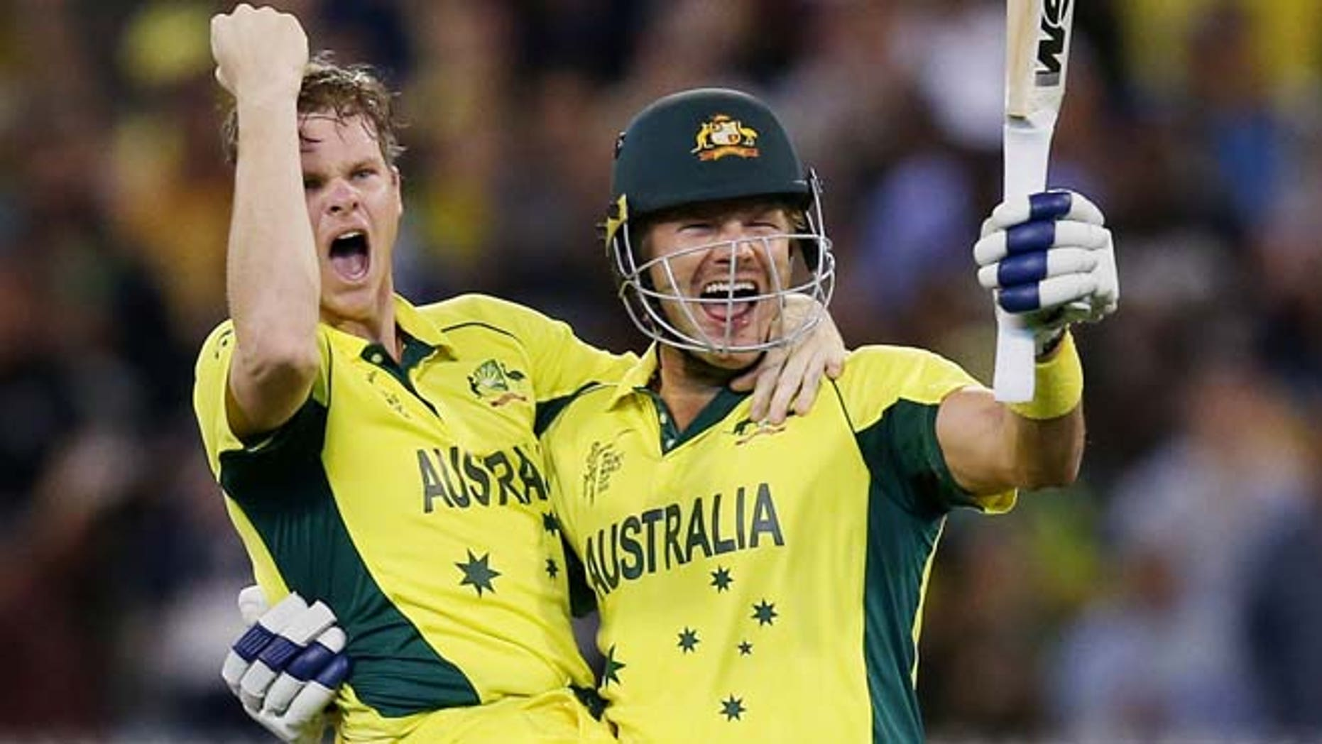March 29, 2015: Australia's Steve Smith, left, and teammate Shane Watson celebrate after defeating New Zealand by seven wickets to win the Cricket World Cup final in Melbourne, Australia.