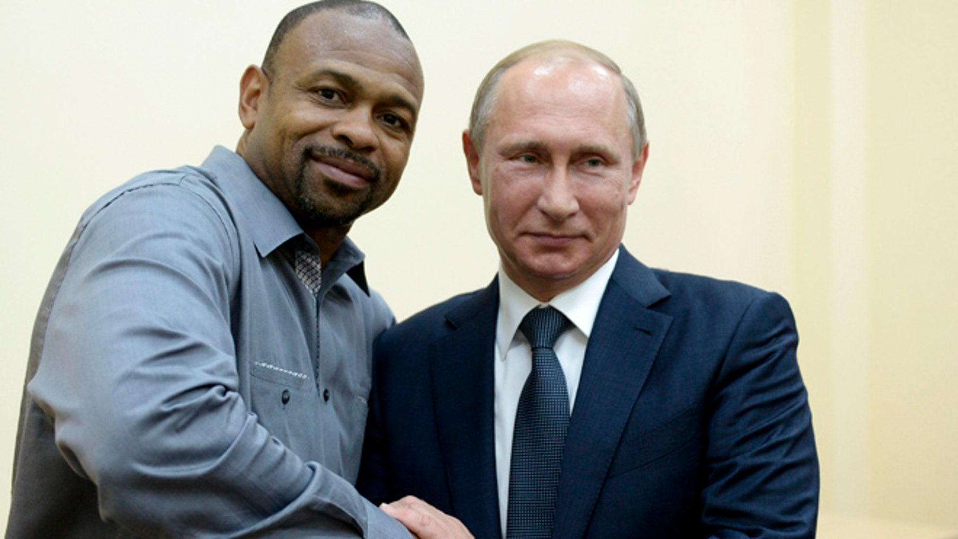 Aug. 19, 2015: Russian President Vladimir Putin, right, meets with American boxer Roy Jones Jr. in Sevastopol, Crimea.