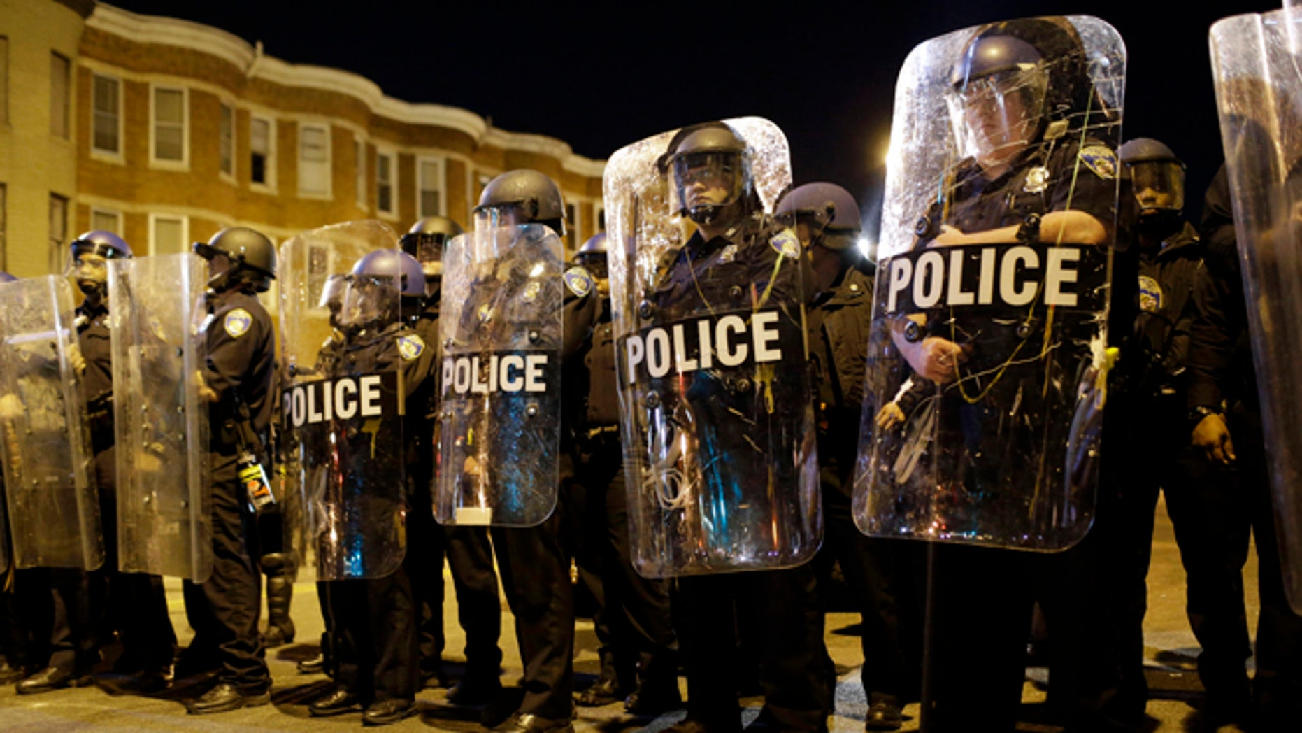 Baltimore police in formation, a day after unrest that occurred following Freddie Gray's funeral back in April.