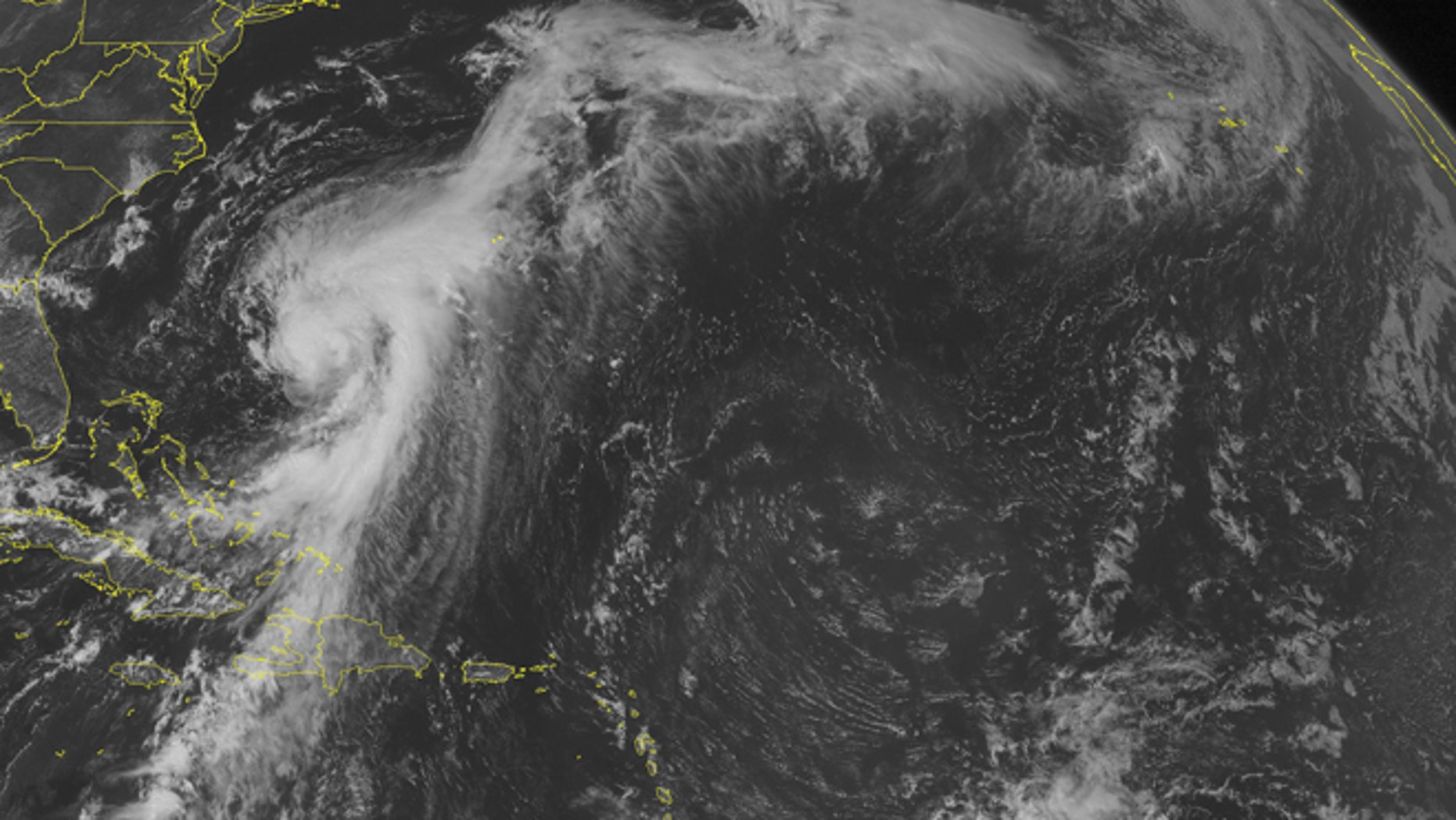 This NOAA satellite image taken Tuesday, Aug. 26, 2014 at 01:45 PM EDT shows some stormy weather across the Caribbean. The most noticeable weather is occurring over Cuba and the Bahamas. This is from the tail end of Hurricane Cristobal. The storm has winds sustained at 75 MPH and is moving away from land.  (AP Photo/Weather Underground)