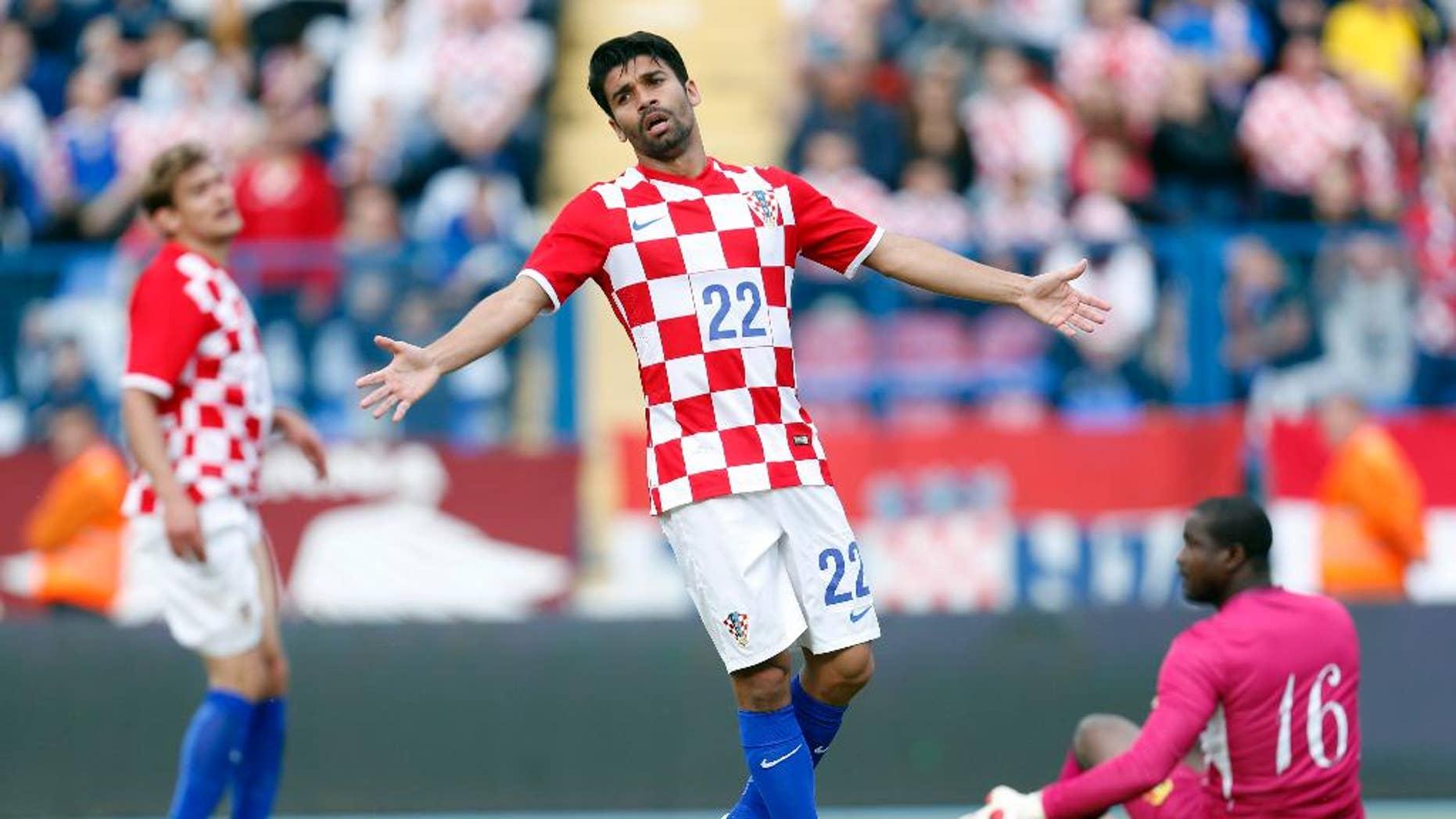 Croatia's Eduardo Da Silva  gestures  during the internationa friendly soccer match between Croatia and Mali, in Osijek, Croatia, Saturday, May 31, 2014. (AP Photo/Darko Bandic)
