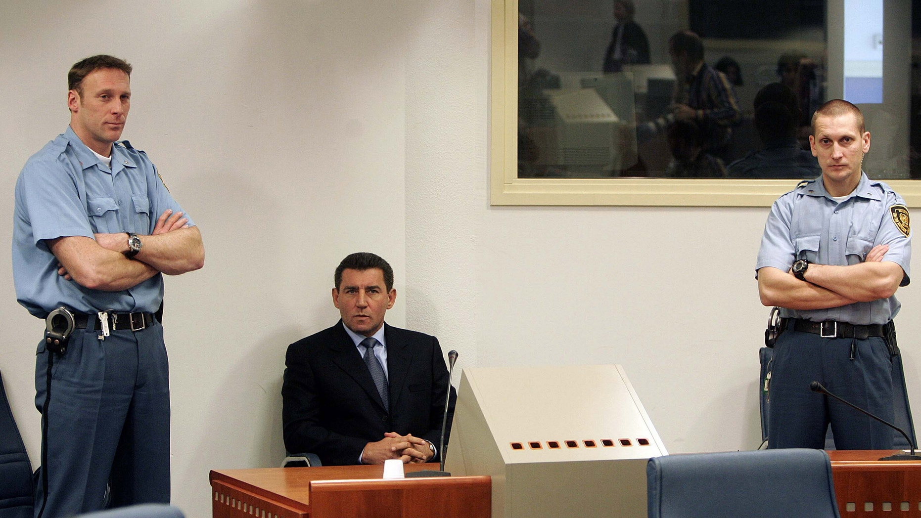 FILE: Former Croatian General Ante Gotovina, center, during his initial appearance at the courtroom of the Yugoslav war crimes tribunal in The Hague, the Netherlands.