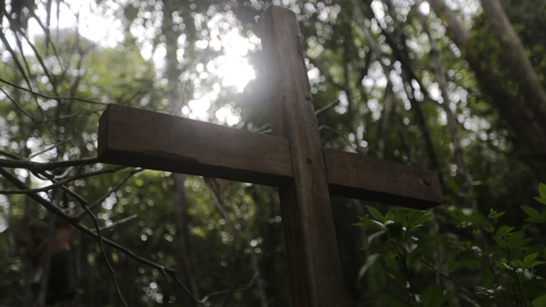A cross made of wood stands alone in the place where activist Antonio Isidio was found dead last December inside the community of Vergel.