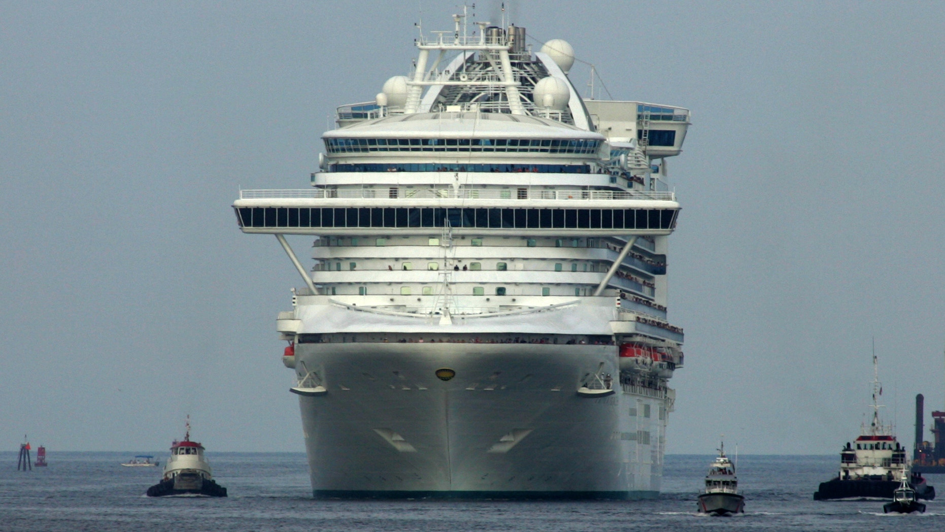 The cruise ship Crown Princess travels into Port Canaveral, Florida.