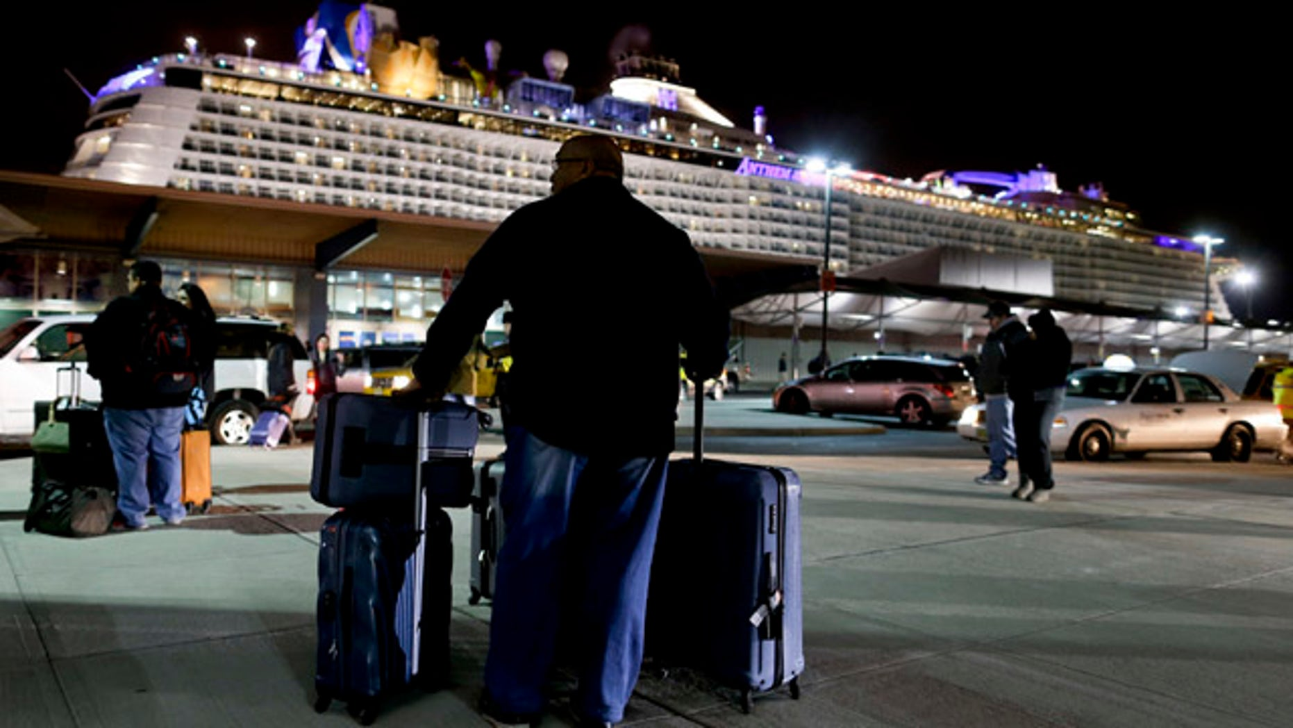 Feb. 10, 2016: A passenger from the Royal Caribbean cruise ship, Anthem of the Seas, awaits transportation after arriving at Cape Liberty cruise port in Bayonne, N.J. (AP Photo/Julie Jacobson)