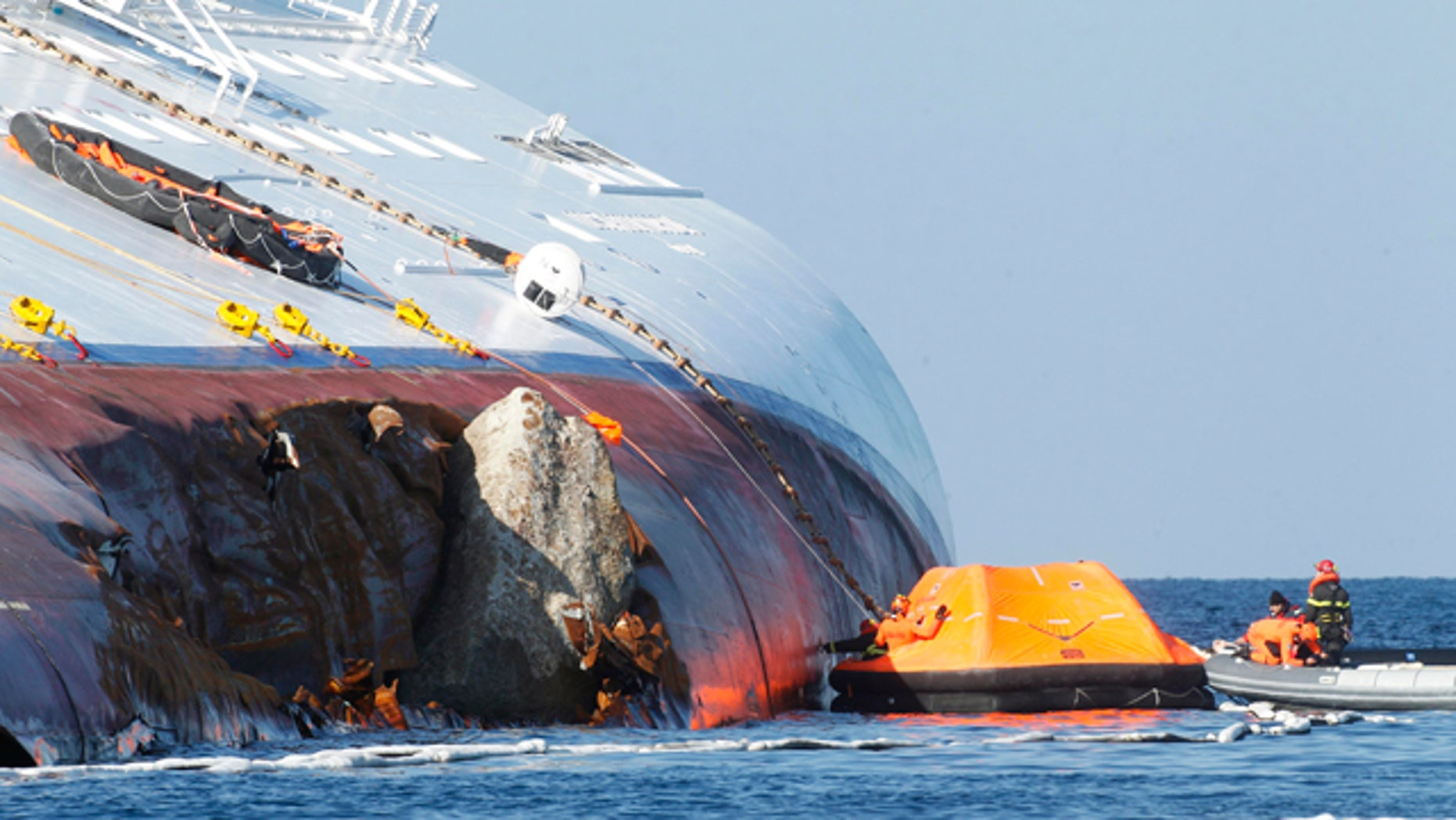 Jan. 24: Oil recovery experts work near the flaw of the grounded cruise ship Costa Concordia off the Tuscan island of Giglio, Italy.
