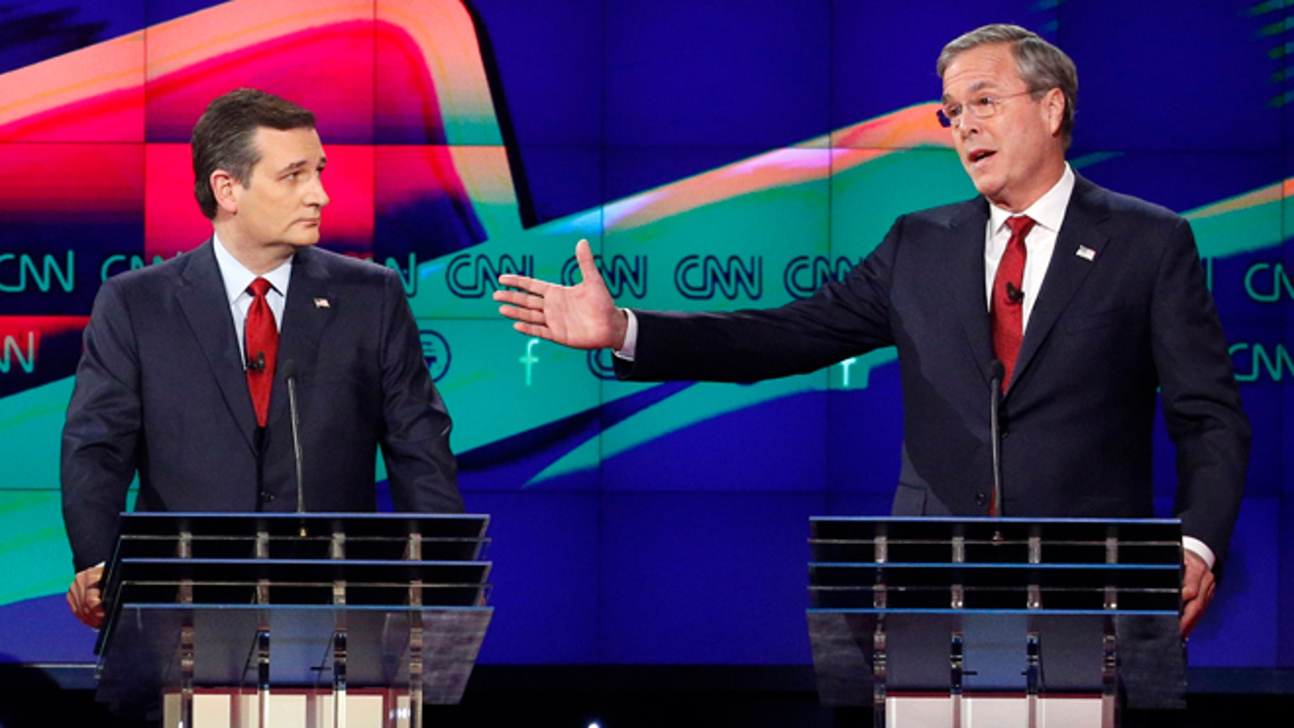 FILE - In this Dec. 15, 2015 file photo, former Florida Gov. Jeb Bush, right, makes a point as Sen. Ted Cruz, R-Texas listens on during the Republican presidential debate in Las Vegas. Ted Cruz once proudly wore a belt buckle reading President of the United States borrowed from George H.W. Bush. He campaigned and worked for, and helped write a book lavishing praise on, that former presidents son, Dubya. And the endorsement of George P. Bush, the familys latest rising political star, lent credibility to Cruzs then little-known 2012 Senate campaign. (AP Photo/John Locher, File)