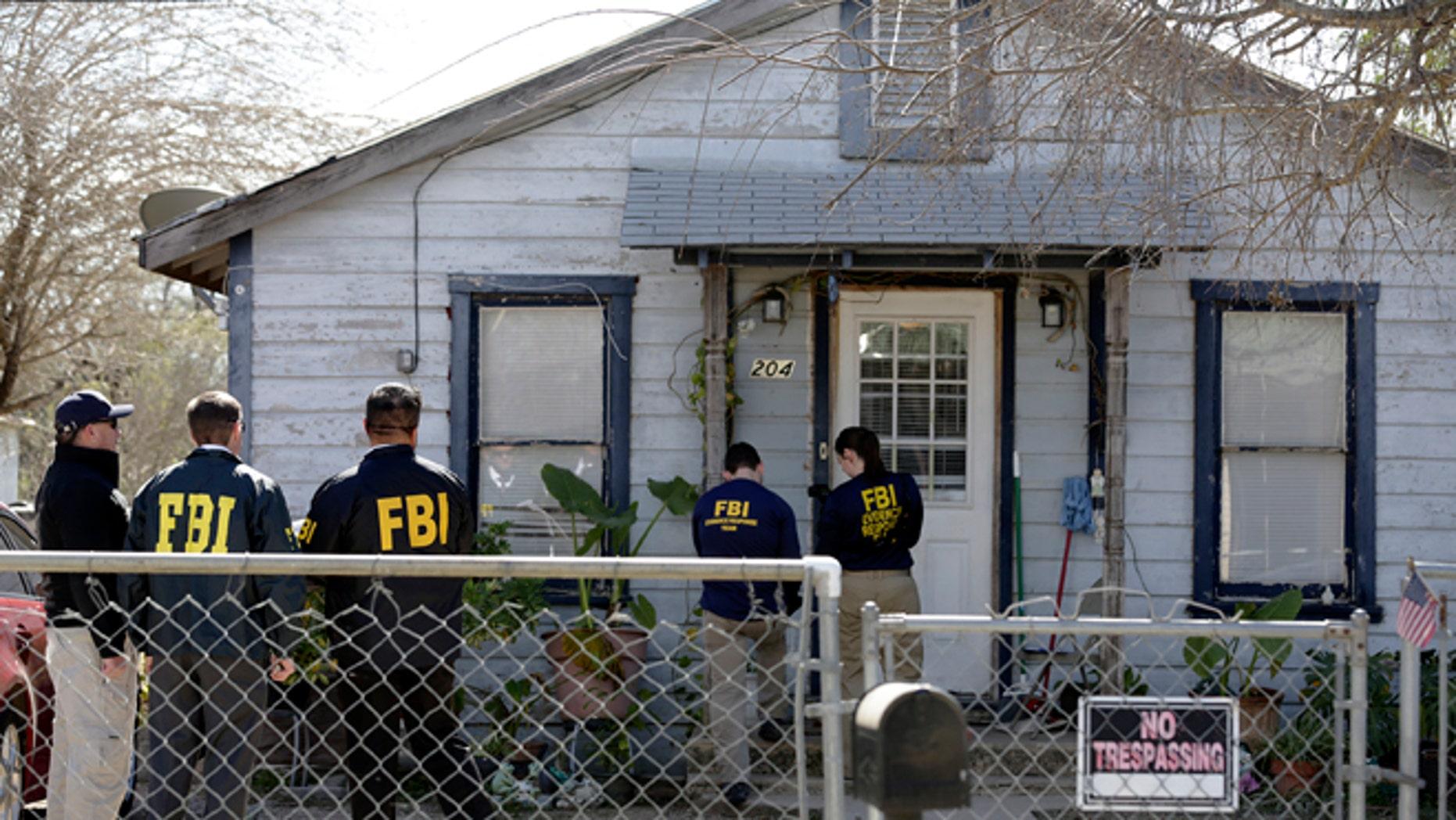FBI agents outside the home of Mayor Ricardo Lopez for his arrest on Thursday, Feb. 4, 2016.