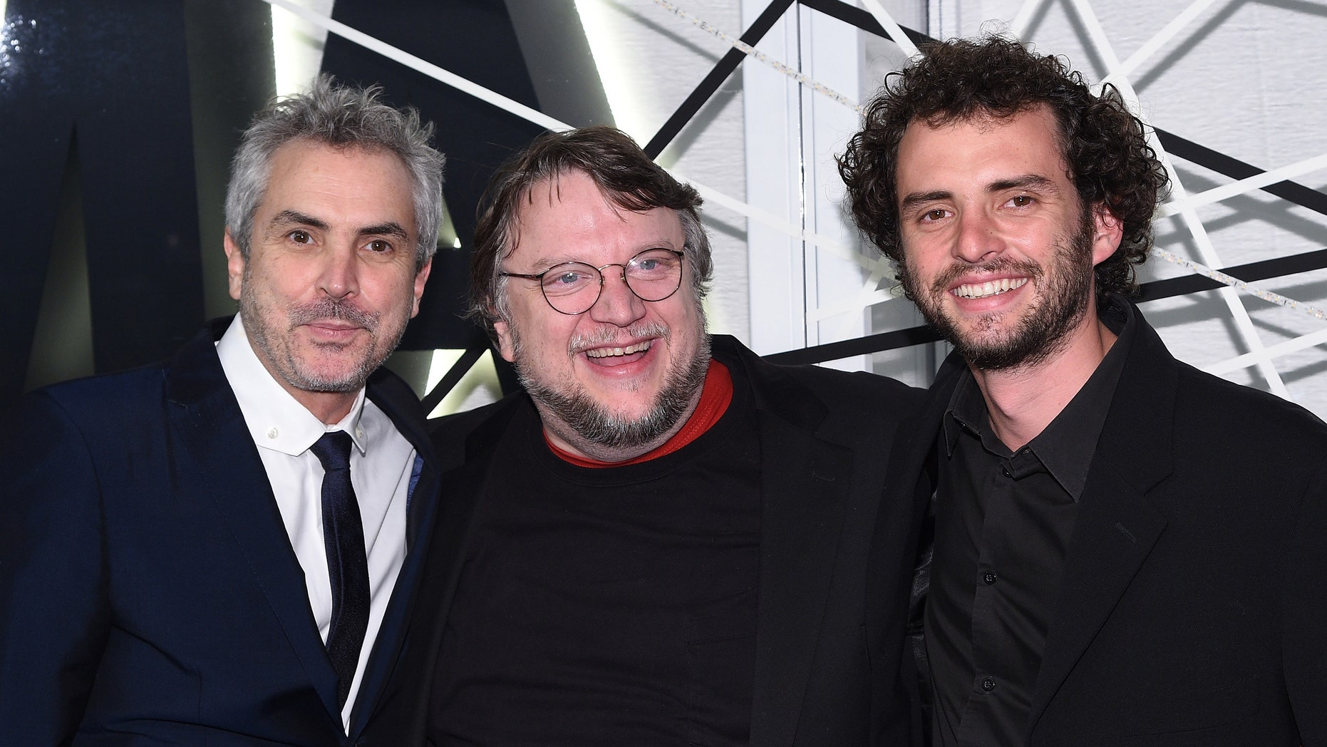 NEW YORK, NY - NOVEMBER 10:  (L-R) Alfonso Cuaron, Guillermo del Toro, and Jonas Cuaron attend The Museum of Modern Art's 2014 Film Benefit Honoring Alfonso Cuaron at The Museum of Modern Art on November 10, 2014 in New York City.  (Photo by Andrew H. Walker/Getty Images)