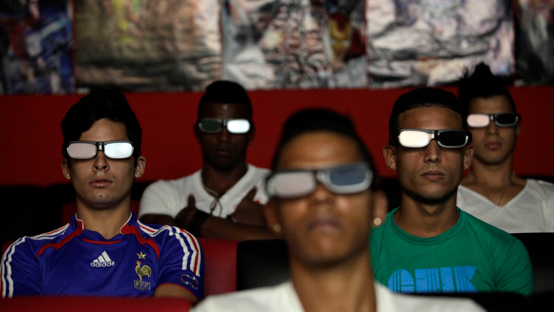 People watch a 3D movie at a private movie theater in Havana, Cuba, Monday, Oct. 28, 2013. Cuban entrepreneurs have quietly opened dozens of backroom video salons over the last year, seizing on ambiguities in licensing laws to transform cafes and childrenâs entertainment parlors into a new breed of private business unforeseen by recent official openings in the communist economy. (AP Photo/Franklin Reyes)