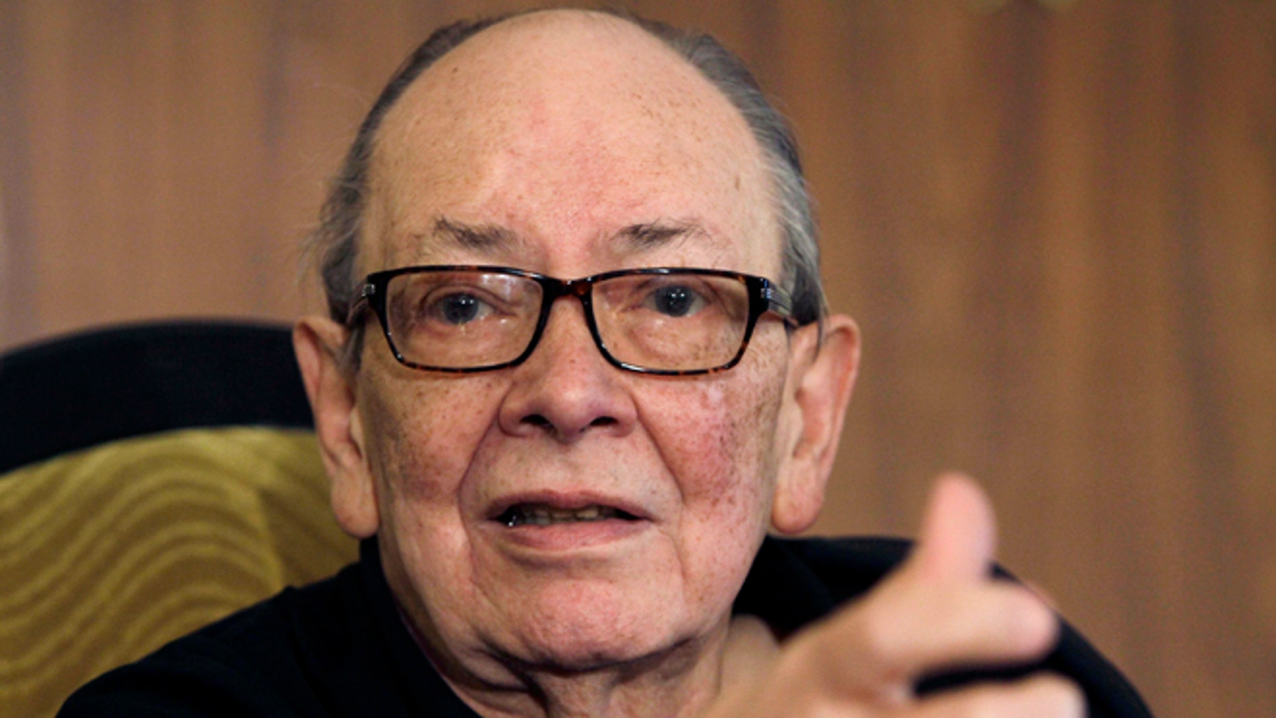In this photo taken Nov. 13, 2012, Alfredo Guevara, president of the International Festival of New Latin American Cinema, speaks during a press conference in Havana, Cuba. The filmmaker, who was recognized as one of Cuba's main cultural leaders, died Friday morning, April 19, 2013. He was 87. (AP Photo/Franklin Reyes)