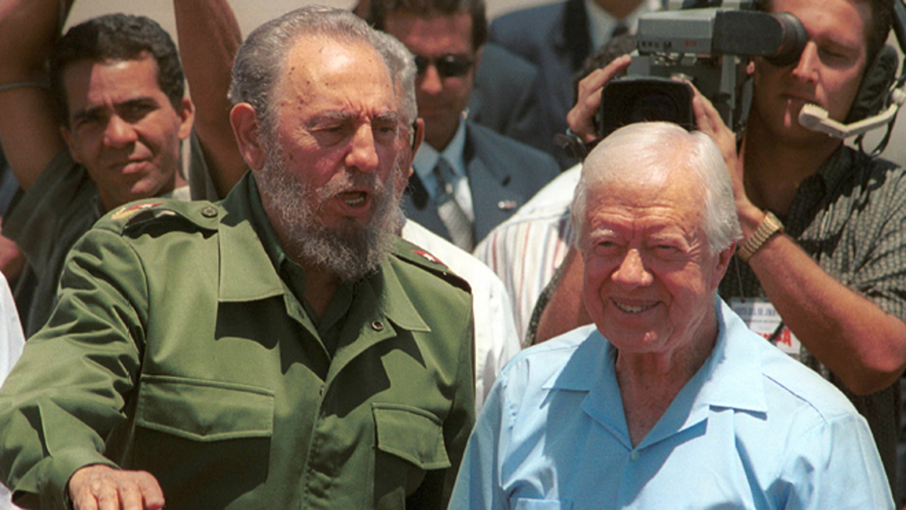 405512 01: Cuban leader Fidel Castro (L) speaks with the former U.S. President Jimmy Carter during a departure ceremony at Jose Marti International airport May 17, 2002 in Havana, Cuba. Carter visited for six days in an effort to improve relations between the U.S. and Cuba. (Photo by Jorge Rey/Getty Images)