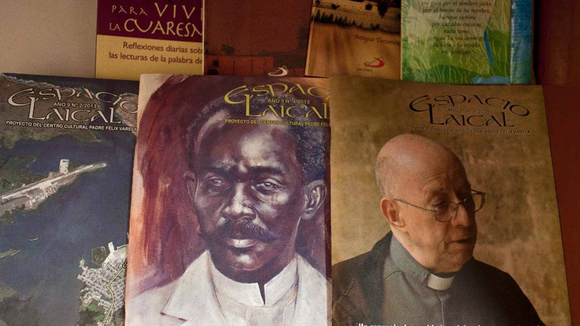 This June 25, 2014, photo, shows issues of the Roman Catholic magazine Espacio Laical exhibited for sale in a small shop in Old Havana, Cuba. The editors of the magazine, Roberto Veiga and Lenier Gonzalez resigned in early May, later confirming they quit because the magazine's content was controversial in the ecclesiastical community. The magazine's director, Gustavo Andujar, said the editors left voluntarily. (AP Photo/Franklin Reyes)