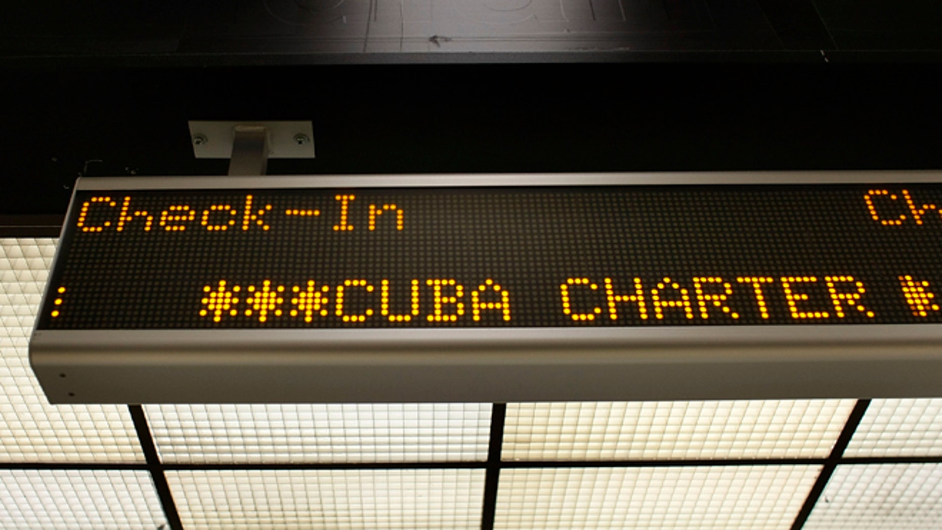 MIAMI - APRIL 07:  A check-in sign for the ABC Charter flight to Cuba is seen at Miami International Airport on April 7, 2009 in Miami, Florida. Reports indicate that U.S. President Barack Obama plans to loosen restrictions on family travel and remittances to Cuba.  (Photo by Joe Raedle/Getty Images)