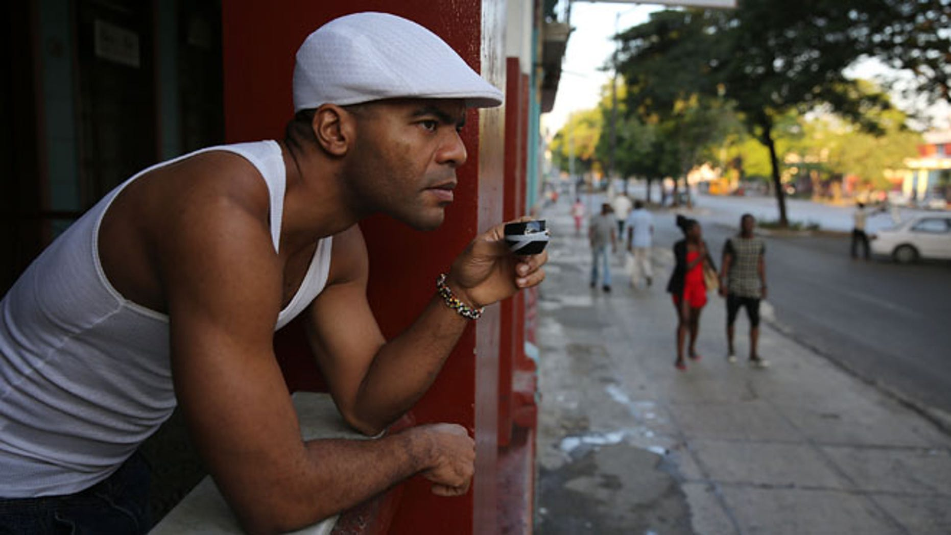 A man has his morning coffee in Havana, Cuba. (Photo by Joe Raedle/Getty Images)