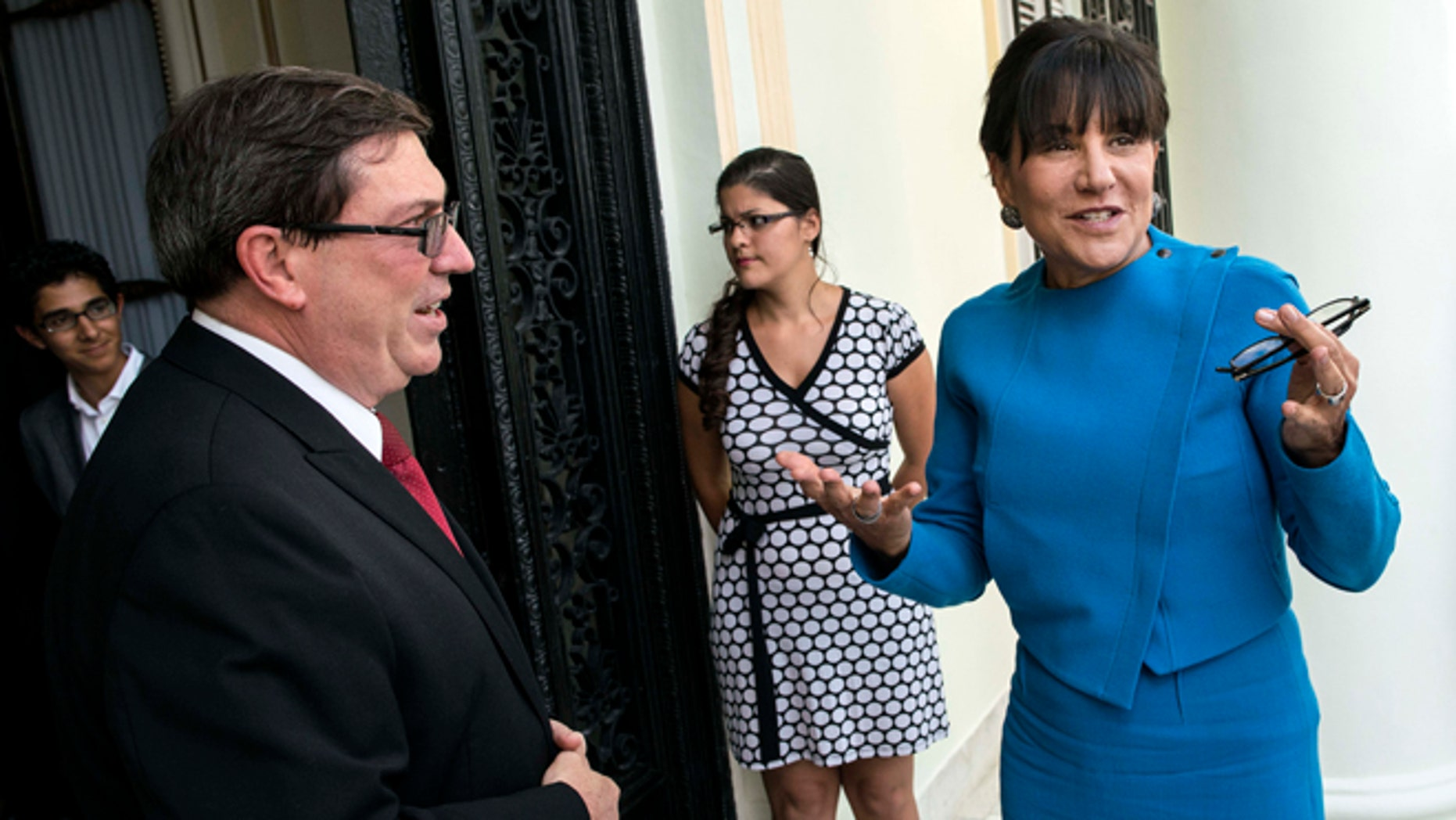 U.S. Commerce Secretary Penny Pritzker, right, talks with Cuba's Foreign Minister Bruno Rodriguez before a meeting in Havana, Cuba, Wednesday, Oct. 7, 2015. Pritzker is leading a delegation of officials from the U.S. Treasury, Commerce and State departments for meetings with officials from Cuban government ministries and businesses.(AP Photo/Ramon Espinosa)