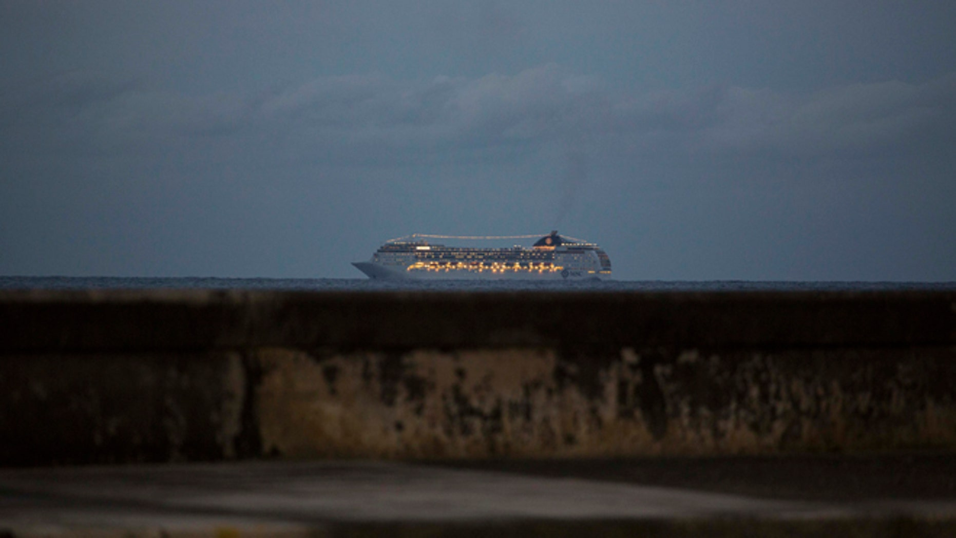 This Jan. 21, 2016 photo shows the MSC Opera cruiser off the coast of Havana as it departs Cuba. Cuban state media announced on Friday, April 22, 2016 the loosening of the government's policy that banned Cuban-born people from arriving by sea. Those prohibitions were put in place in response to Cuban exiles launching attacks from the water in the first years after the Cuban revolution. (AP Photo/Desmond Boylan)