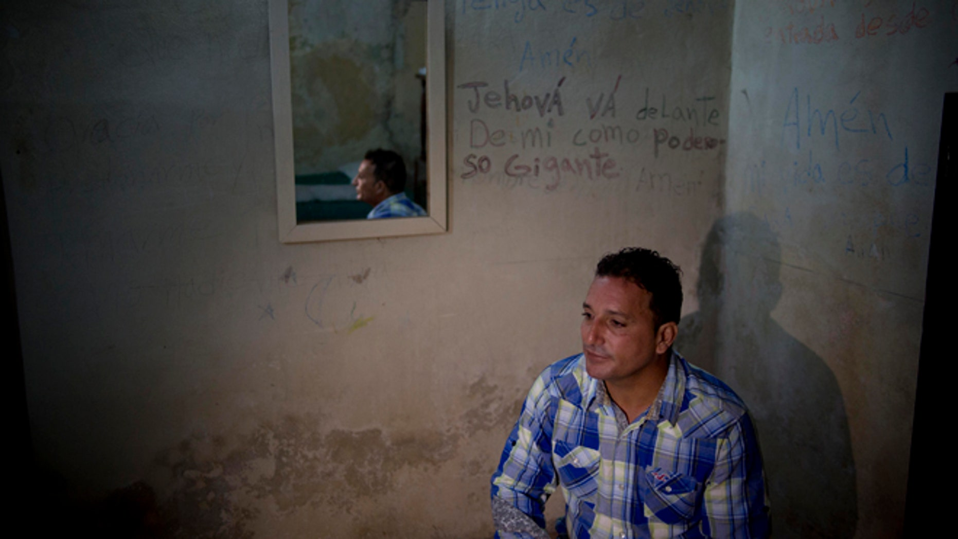 A day after his release, dissident Wilberto Parada, 42, sits for an interview in his home in Havana, Cuba, Friday, Jan. 9, 2015. Advocates, relatives and dissidents say that Cuba has freed at least 38 people on a U.S. list of imprisoned opposition members. U.S. officials said Friday after weeks of virtual silence that those released had been on the list of 53. (AP Photo/Ramon Espinosa)