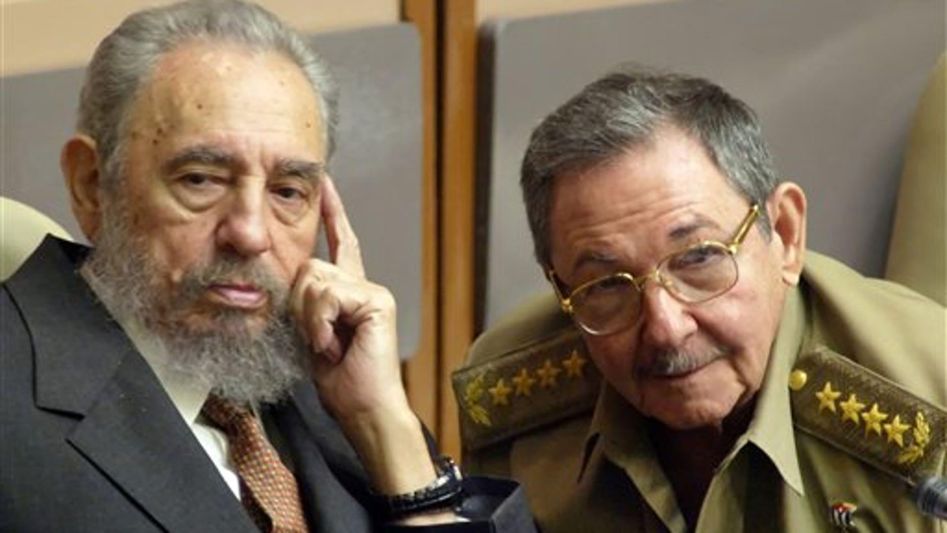 Fidel and Raul Castro, in a 2004 file photo.