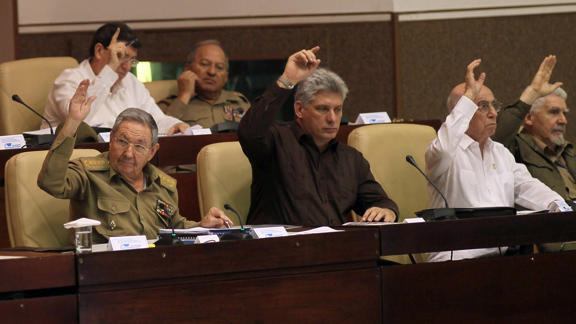 Cuba's President Raul Castro, Cuba's Vice-President Miguel Diaz-Canel and  First Vice-President of the Council of State Jose Ramon Machado Ventura during an extraordinary session at the National Assembly in Havana, Cuba, Saturday, March. 29, 2014.