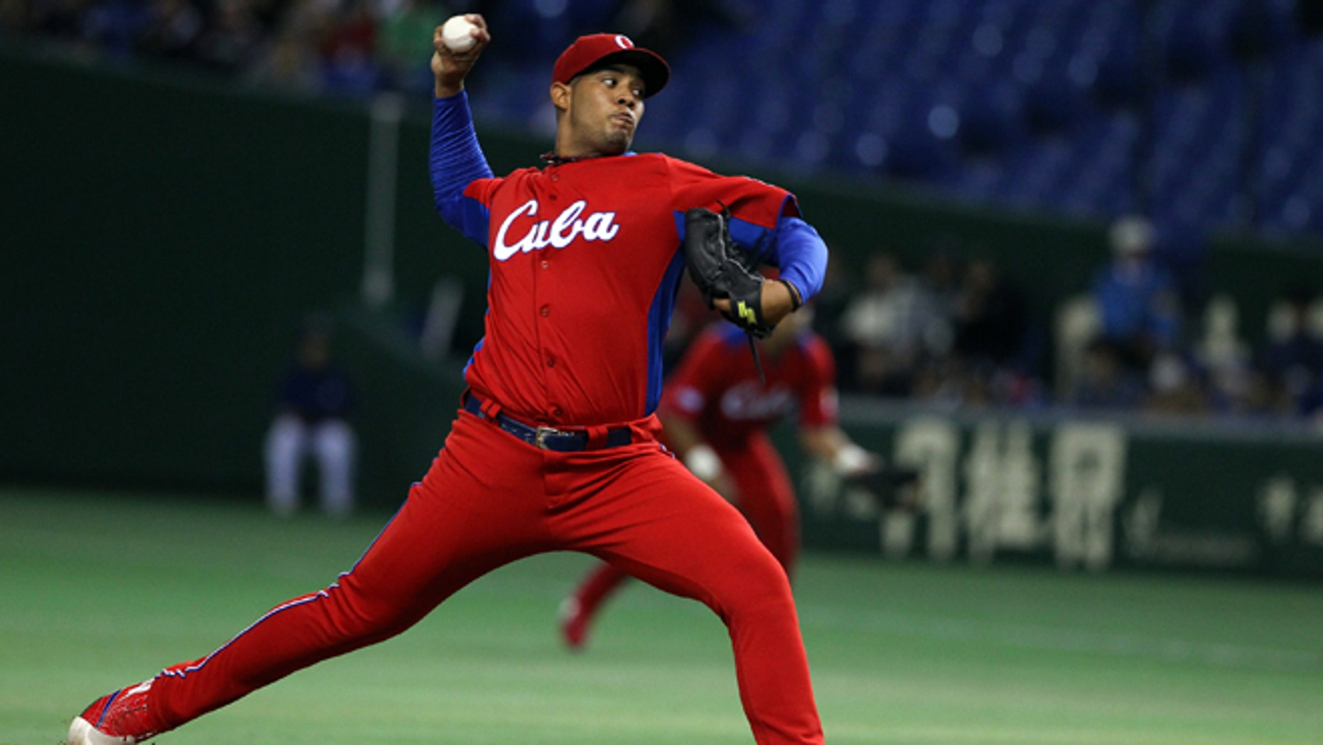 TOKYO, JAPAN - MARCH 11: Starting Pitcher  Vladimir Garcia #34 of Cuba pitches during the World Baseball Classic Second Round Pool 1 game between Cuba and the Netherlands at Tokyo Dome on March 11, 2013 in Tokyo, Japan. (Photo by Koji Watanabe/Getty Images)