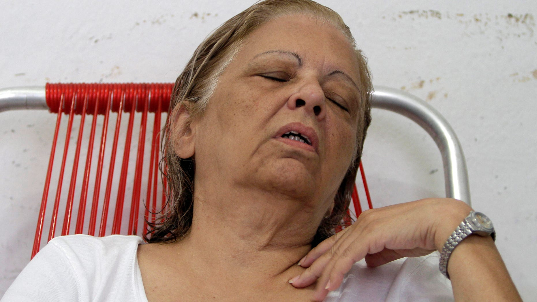 Cuba dissident Martha Beatriz Roque rests after giving an interview in Havana, Cuba, Tuesday, Sept. 11, 2012. The prominent dissident has declared a hunger strike and says 12 other opposition members are joining her.