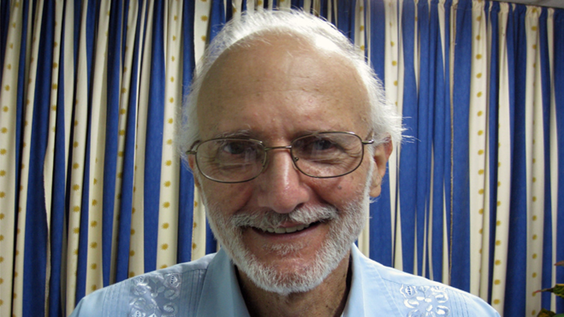 FILE - In this Nov. 27, 2012 file photo provided by James L. Berenthal, shows jailed American Alan Gross poses for a photo during a visit by Rabbi Elie Abadie and U.S. lawyer James L. Berenthal at Finlay military hospital as he serves a prison sentence in Havana, Cuba. The mother of an American man who was imprisoned in Cuba while working to set up Internet access there has died. The family of 92-year-old Evelyn Gross said Wednesday that she died in Plano, Texas. She had suffered from lung cancer. Gross' son Alan Gross was arrested in Cuba in 2009. The Maryland man had been working covertly in Cuba as a subcontractor for the U.S. government's U.S. Agency for International Development.  (AP Photo/James L. Berenthal, File)