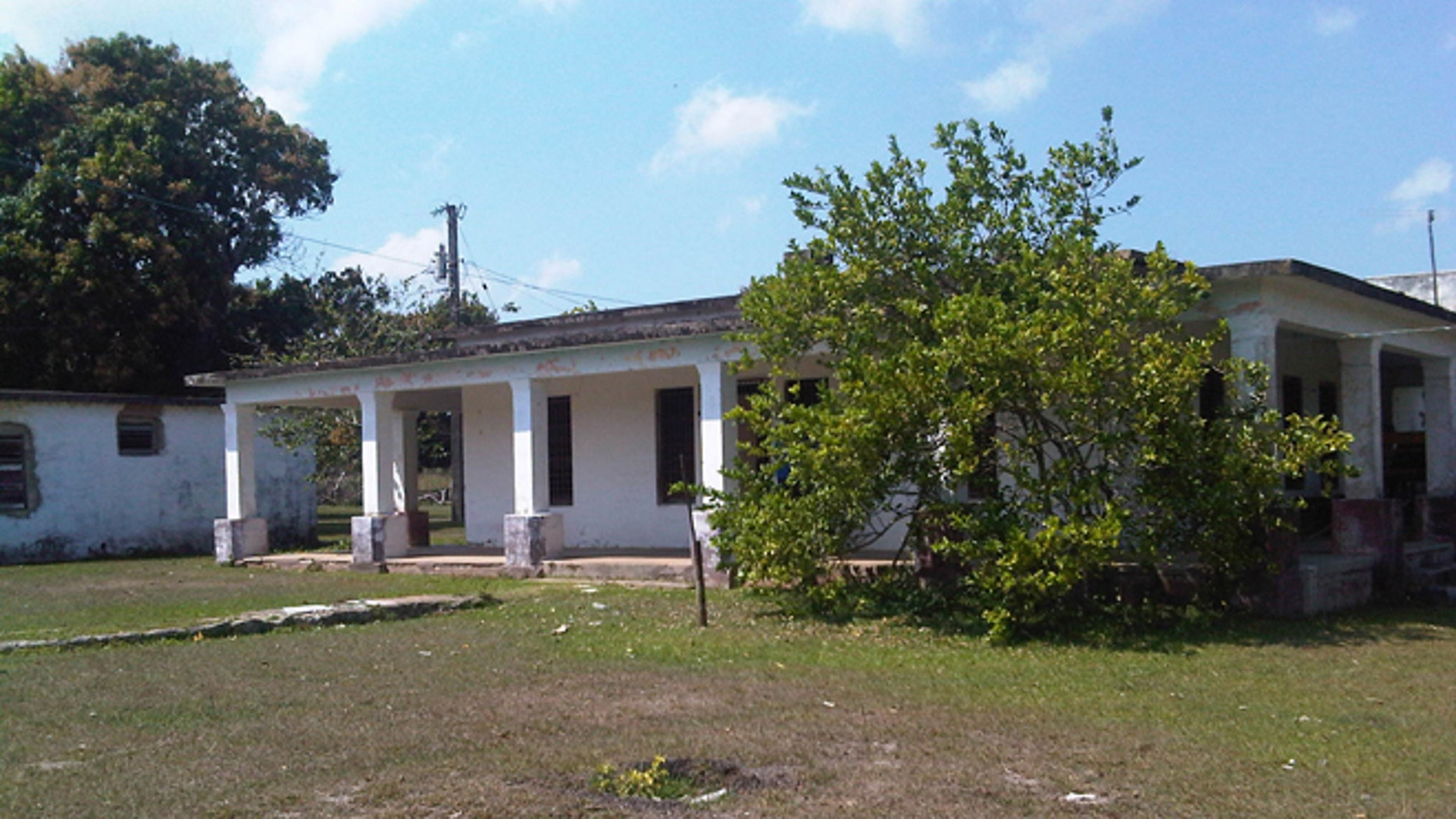 This Friday, March 20, 2105 photo shows the house that used to belong to U.S. citizen Daniel Smith in the Isle of Pines, Cuba. The property was confiscated by the new Cuban government after the revolution. (AP Photo/Milexy Duran)
