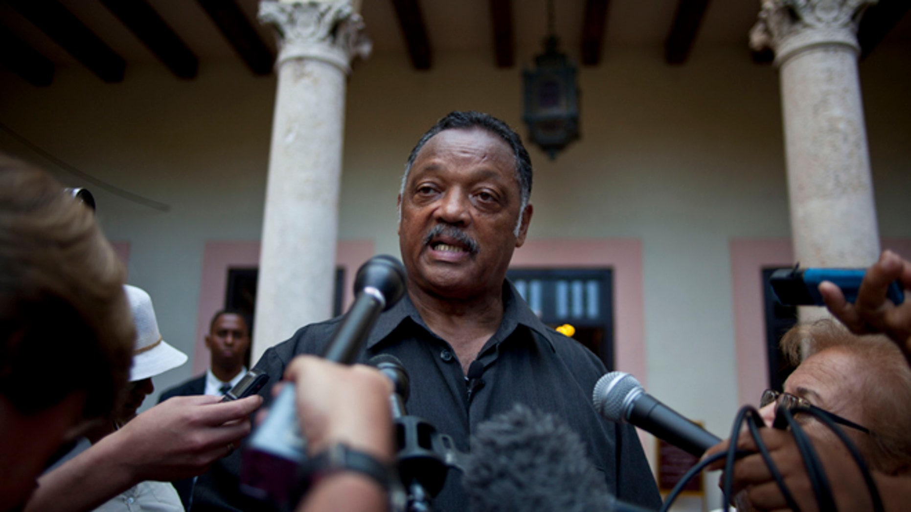 The Rev. Jesse Jackson talks with journalists in 2013.