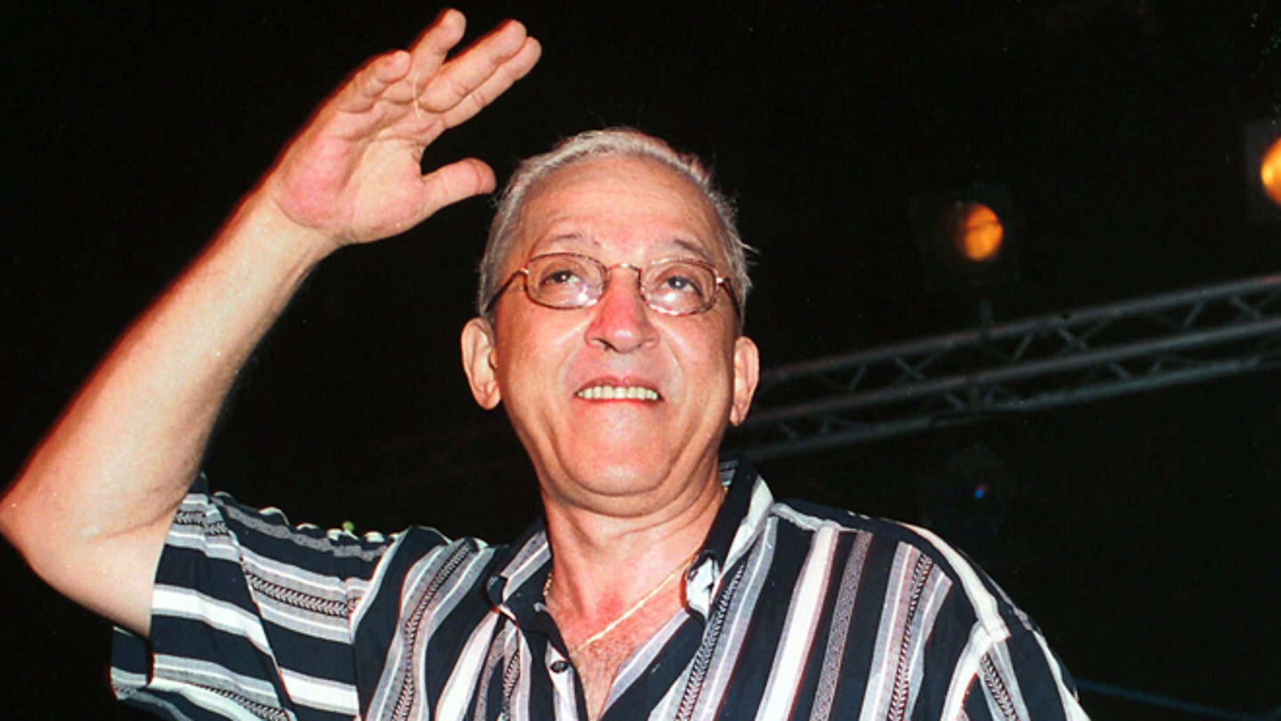 FILE - In this Aug. 26, 2001 file photo, Juan Formell, leader of the Cuban orchestra Los Van Van, performs late Sunday in Havana, Cuba during a farewell summer concert. The noted Cuban musican, who for more than four decades was the driving force behind the big band salsa orchestra Los Van Van, has died. He was 71 years old. Formell's death was announced Thursday, May 1, 2014, on Cuban state television. (AP Photo/Ernesto Mastrascusa, File)