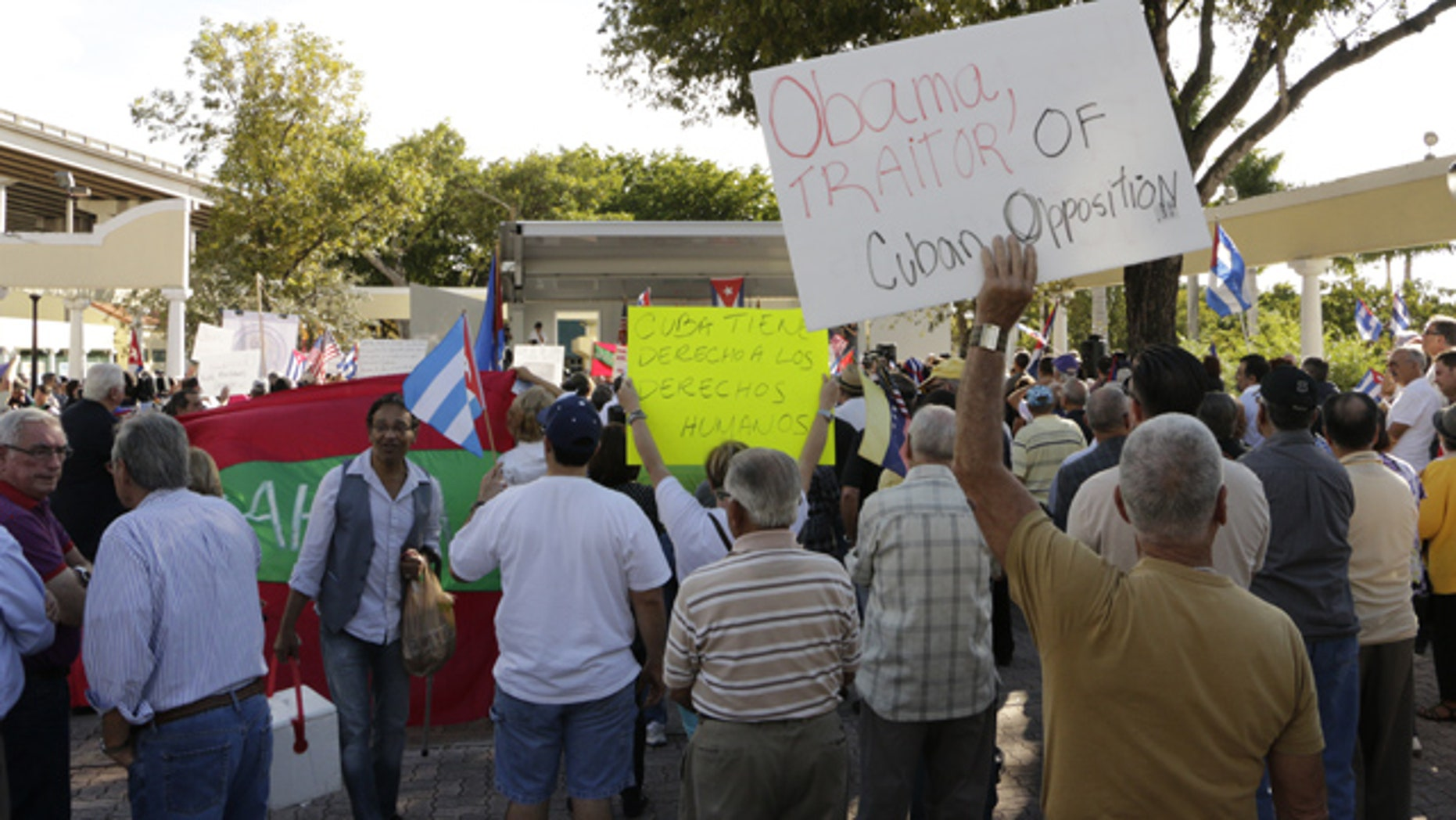 Dec. 20, 2014: More than 200 Cuban-Americans protest President Barack Obama's plan to normalize relations with Cuba in Miami. Many said they felt betrayed by the plan. (AP Photo/Rachel La Corte)