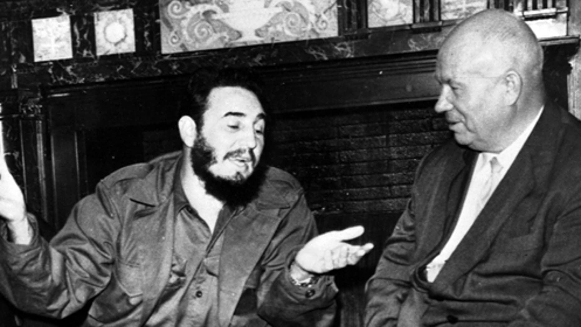 In this Sept. 20, 1960 photo, Cuba's leader Fidel Castro, center, speaks with Soviet Premier Nikita Khrushchev, right, as his Foreign Minister Raul Roa, left, looks on at the Hotel Theresa during the United Nations General Assembly in New York. The world stood at the brink of Armageddon for 13 days in October 1962 when President John F. Kennedy drew a symbolic line in the Atlantic and warned of dire consequences if Soviet Premier Nikita Khrushchev dared to cross it. On the eve of the 50th anniversary of the Cuban missile crisis, historians now say it was behind-the-scenes compromise rather than a high-stakes game of chicken that resolved the faceoff, that both Washington and Moscow wound up winners and that the crisis lasted far longer than 13 days.  (AP Photo/Prensa Latina via AP Images)